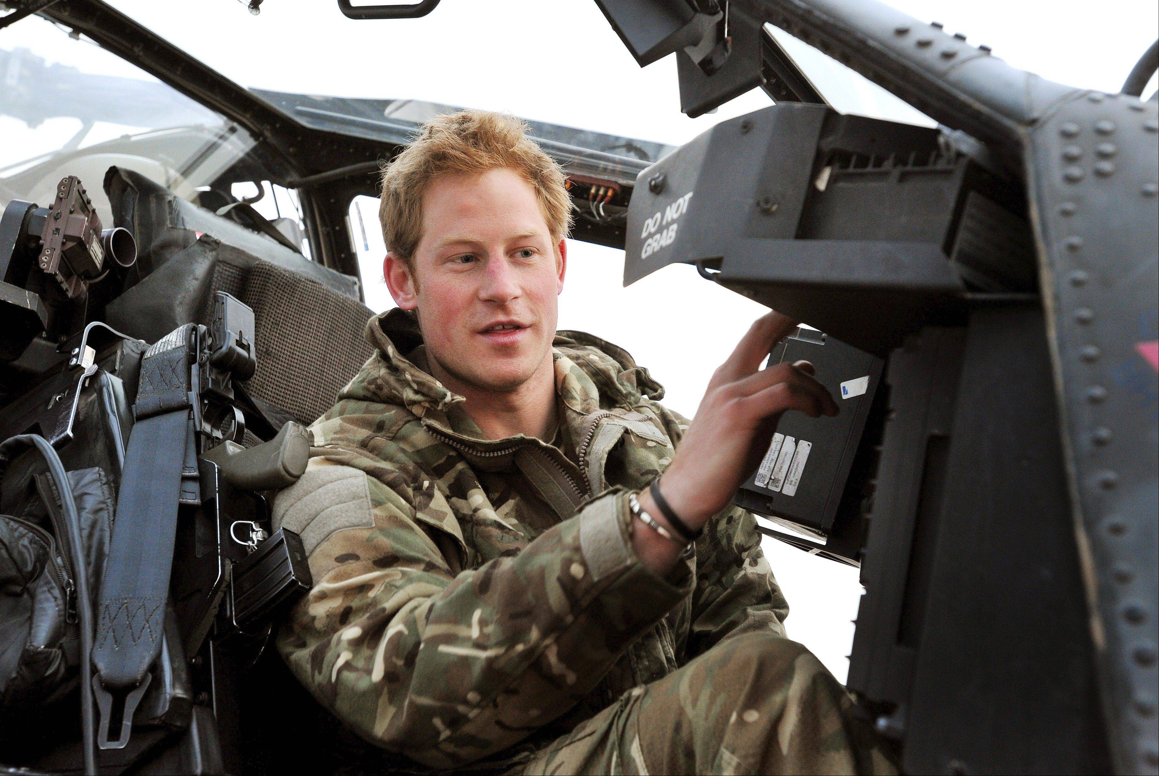 Britain's Prince Harry, or just plain Captain Wales as he is known in the British Army, is seen last month as he makes his early morning pre-flight checks on the flight-line, from Camp Bastion southern Afghanistan.