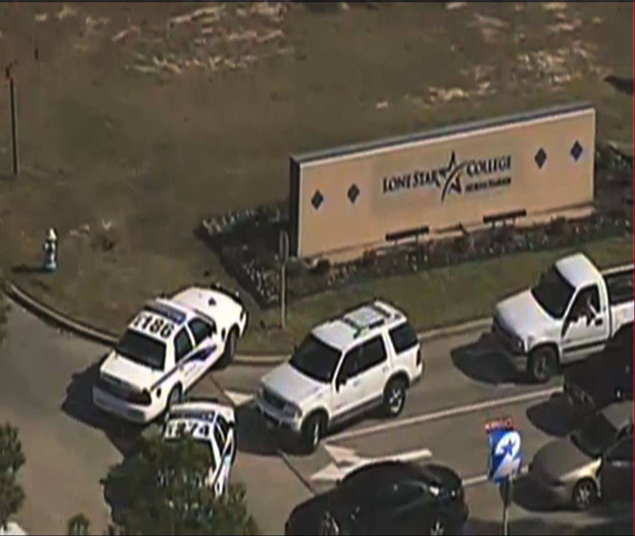 Police vehicles block an entrance to Lone Star College Tuesday in Houston, where gunfire erupted after two people argued, police said.