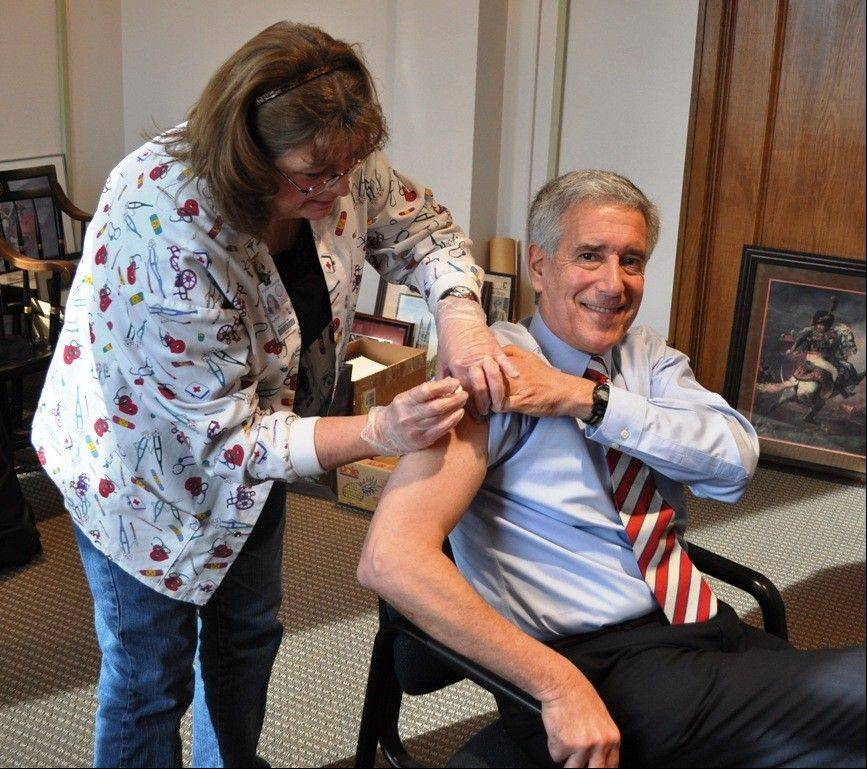 Kane County Board Chairman Chris Lauzen received a flu shot last week in hopes of inspiring local residents to follow the example and cut down on unnecessary emergency room visits.