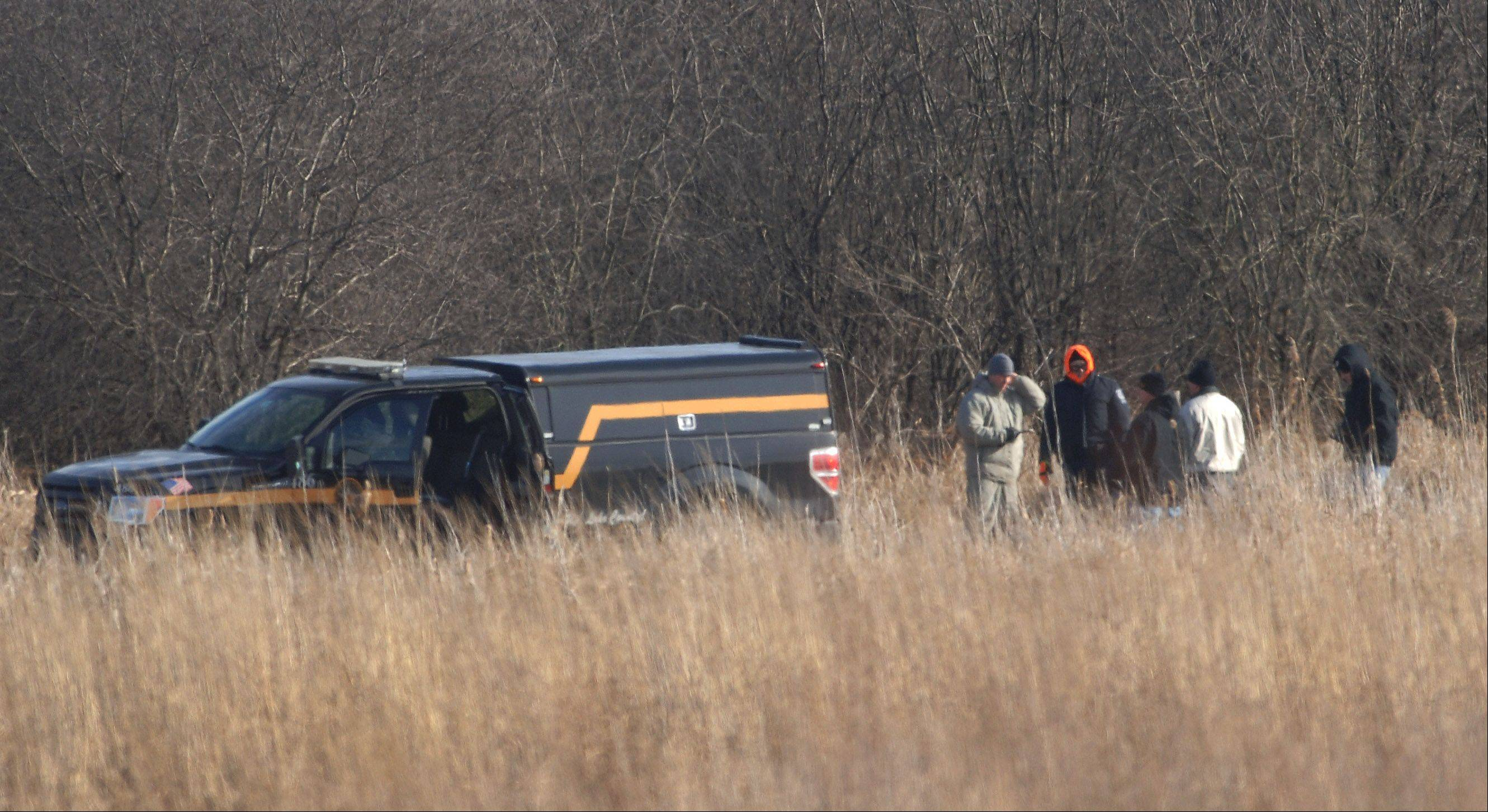 Police search the grounds in Round Lake Park near Campbell Airport on Tuesday for information related to the death of a Grayslake man, who was last seen early Sunday.