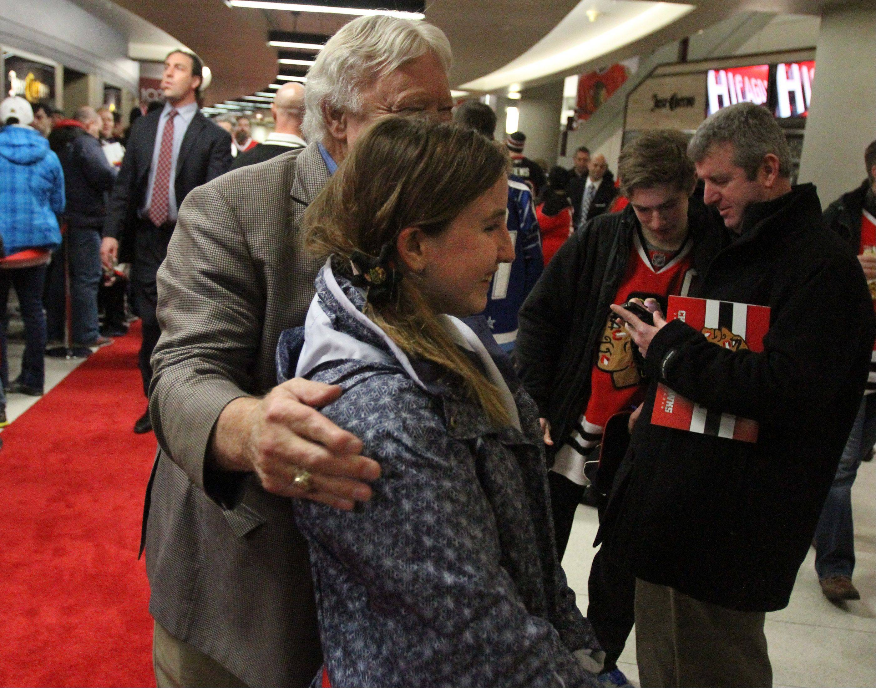 Morgan Taylor, 12, of Crystal Lake has her picture taken with Chicago Blackhawks great Bobby Hull.