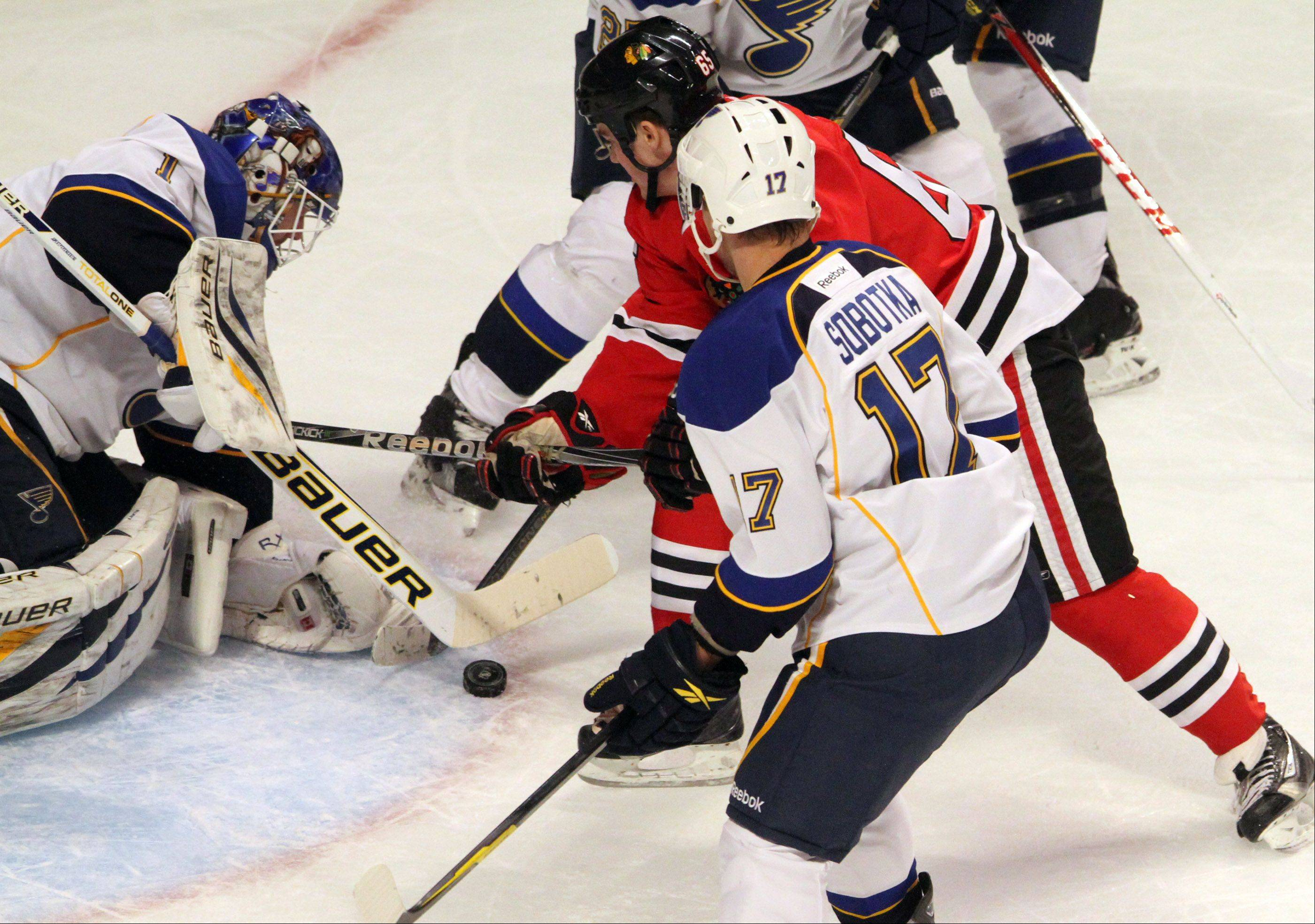 St. Louis Blues goalie Brian Elliott blocks a shot by Chicago Blackhawks left wing Viktor Stalberg during the second period.