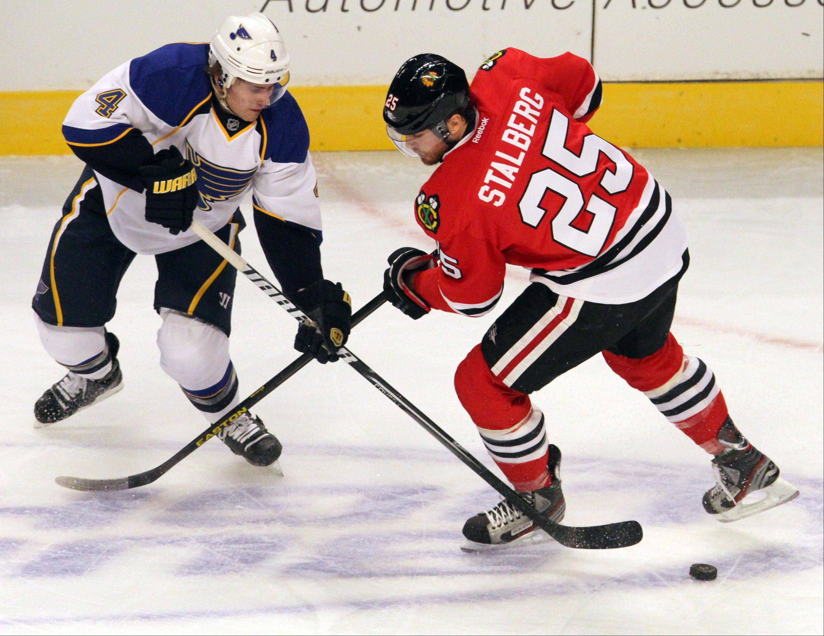 St. Louis Blues defenseman Kris Russell steals the puck from Chicago Blackhawks left wing Viktor Stalberg during the second period.