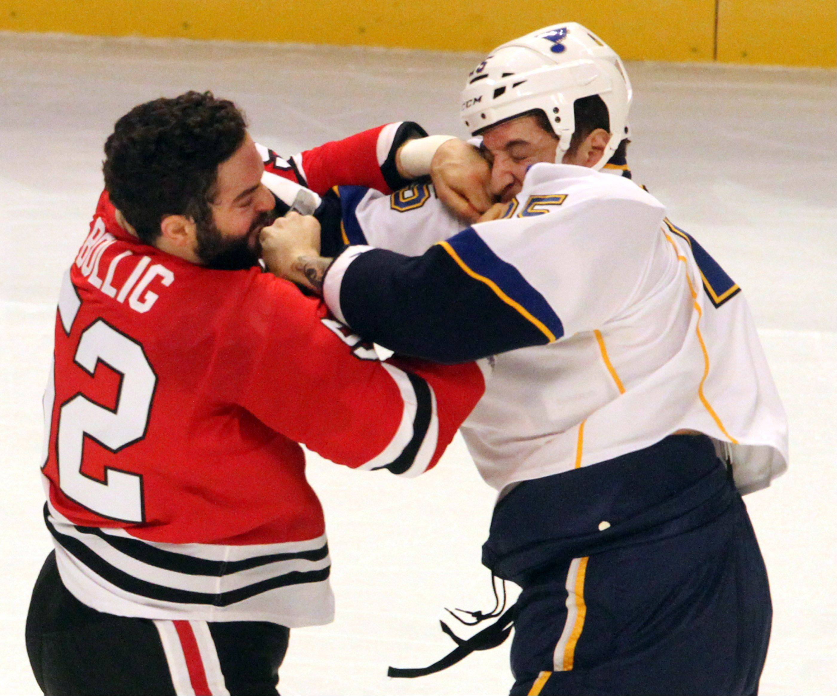 Chicago Blackhawks left wing Brandon Bollig lands a punch in a fight with St. Louis Blues right wing Chris Stewart during the first period .