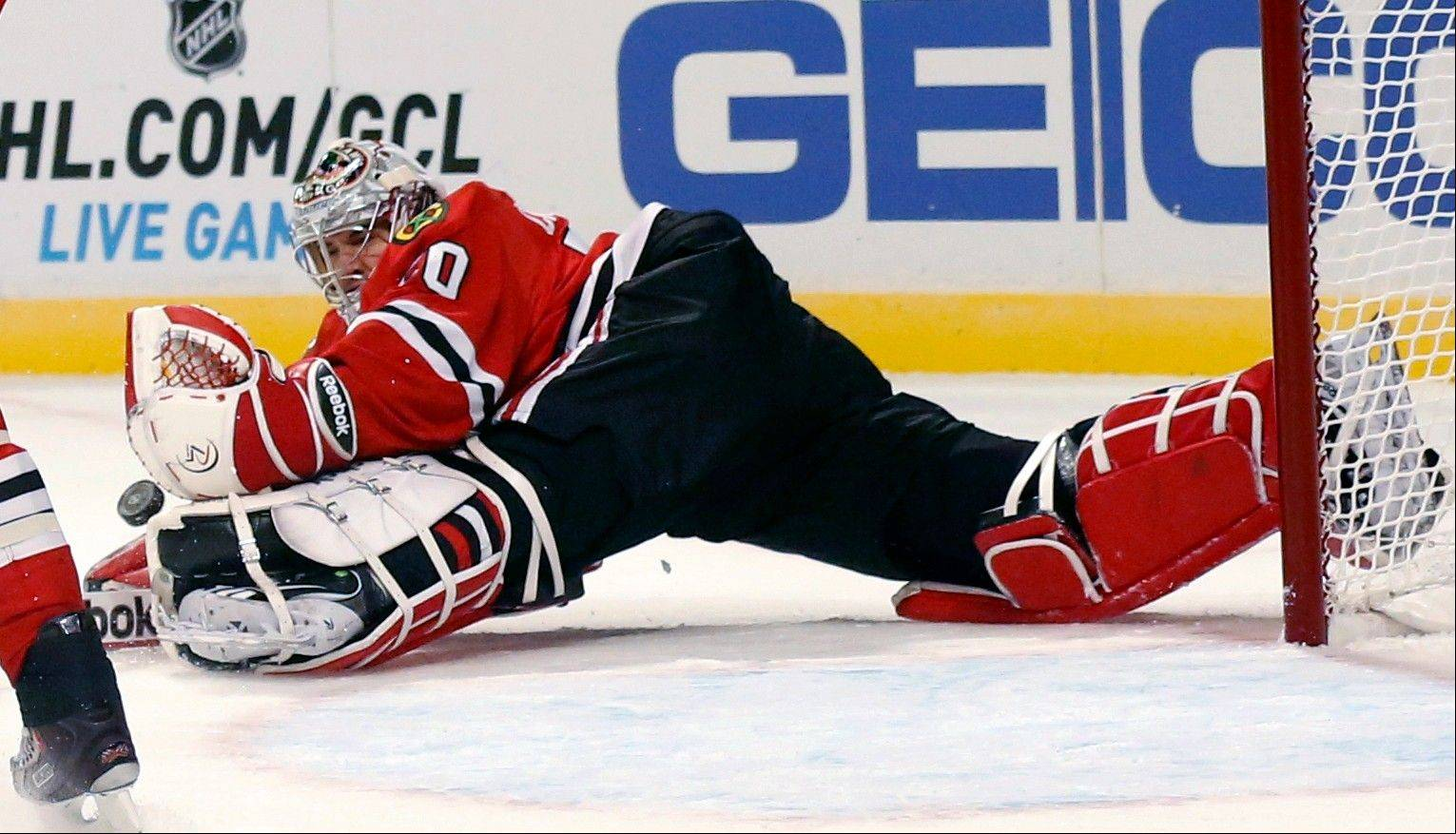 Chicago Blackhawks goalie Corey Crawford makes a save during the first period .
