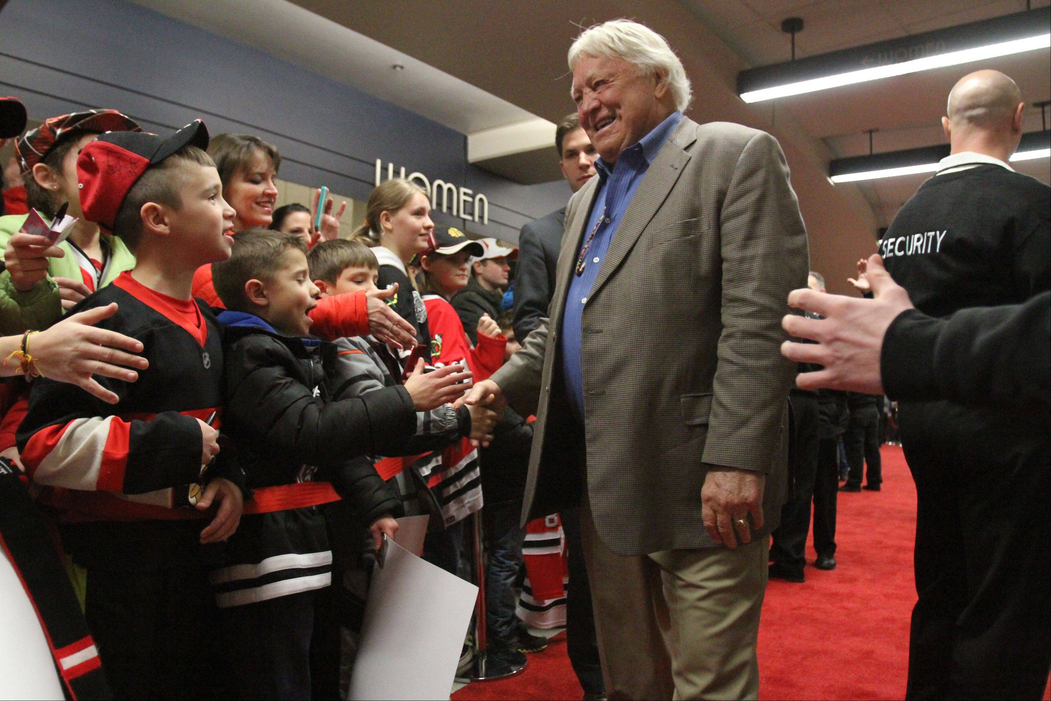 Chicago Blackhawks great Bobby Hull greets fans during the red carpet event before the home opener.