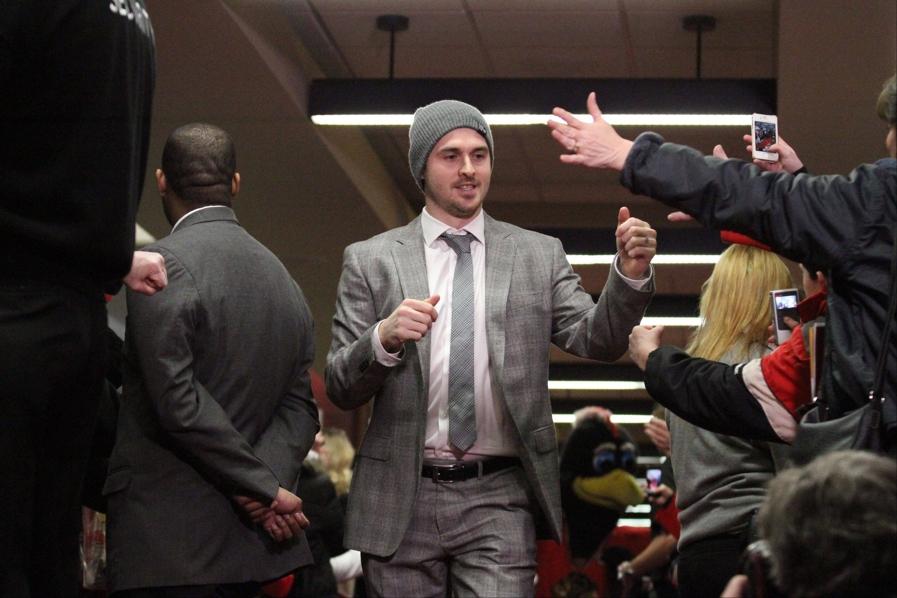 Chicago Blackhawks center Dave Bolland gives a thumbs up to fans during the red carpet event before the home opener.