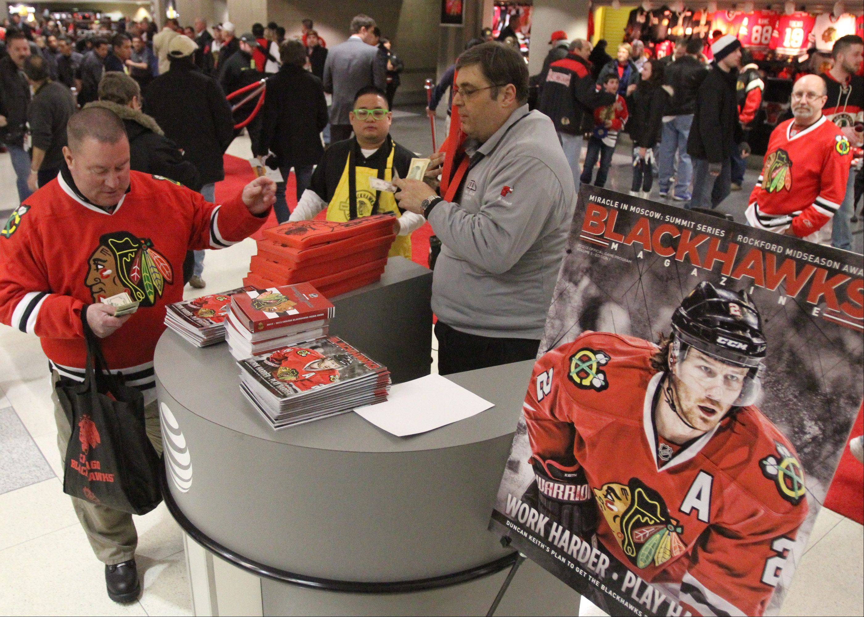 Mike Segvich sells Chicago Blackhawks programs before the game.