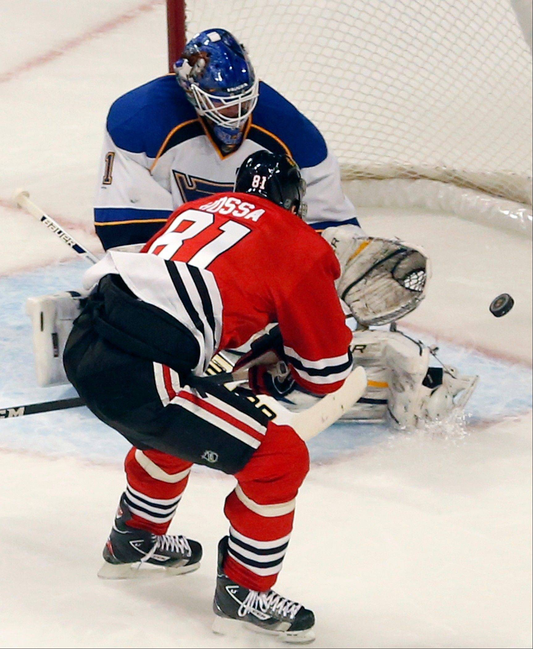 St. Louis Blues goalie Brian Elliott (1) makes a save on a shot by Chicago Blackhawks right wing Marian Hossa (81) during the Hawks 3-2 win over the Blues Tuesday night at the United Center.