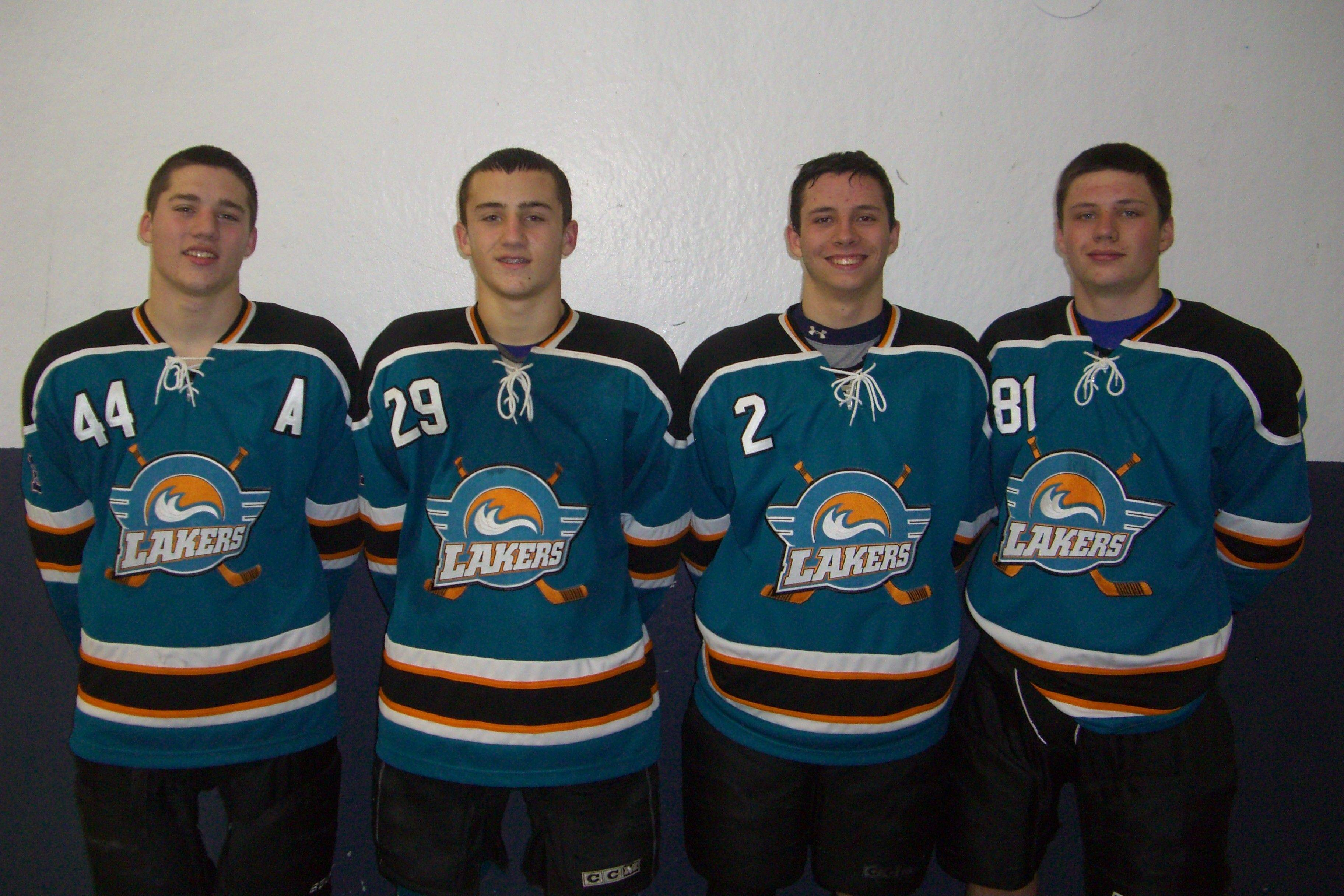 The Lakers hockey team features a pair of rugged brother tandems: Brandon Brumm (44) and Cody Brumm (29) and Anthony Conn (2) and Nikko Conn (81)