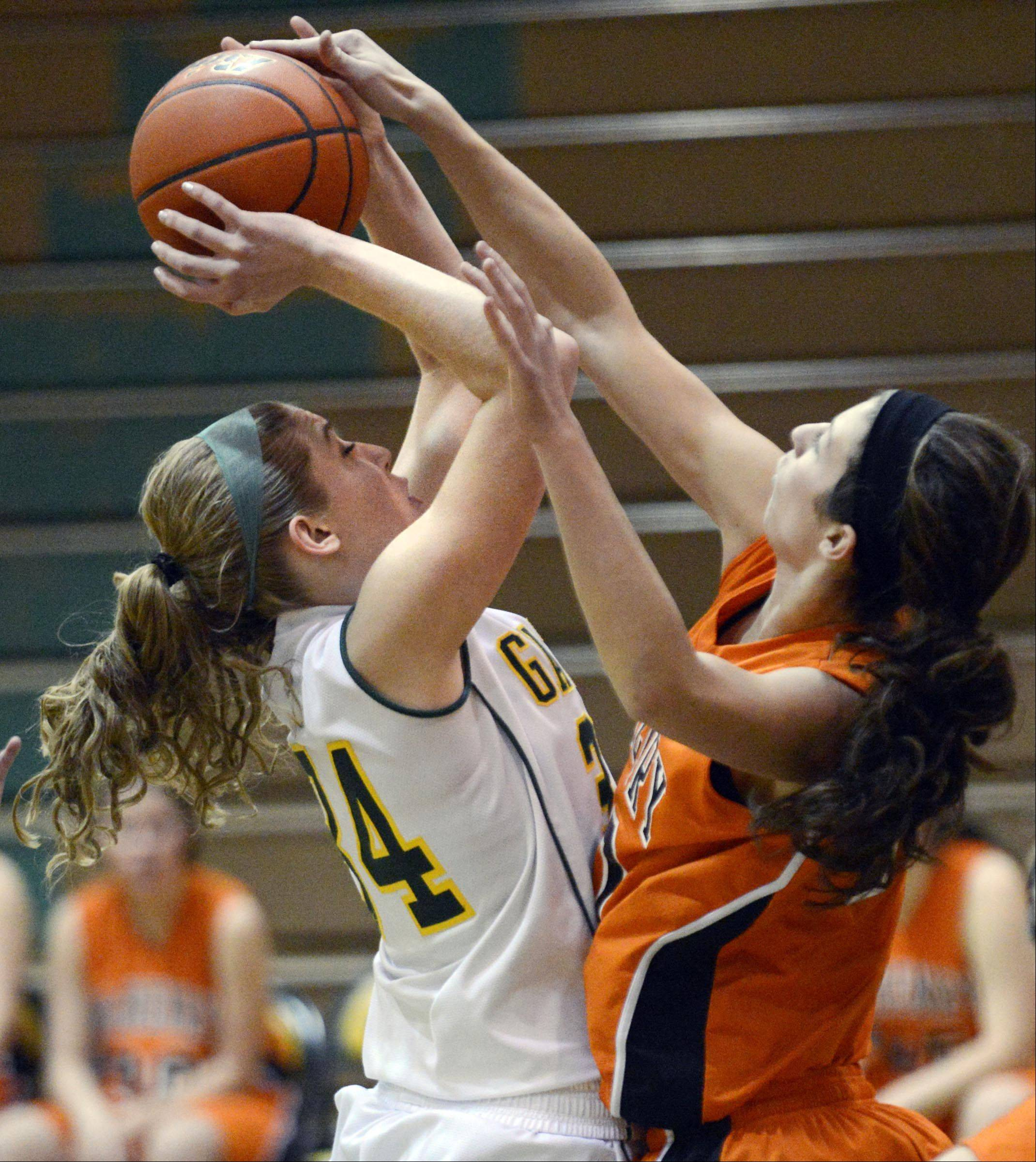 Crystal Lake South's Sara Mickow has her shot blocked by McHenry's Brittany Avonts Wednesday in Crystal Lake.