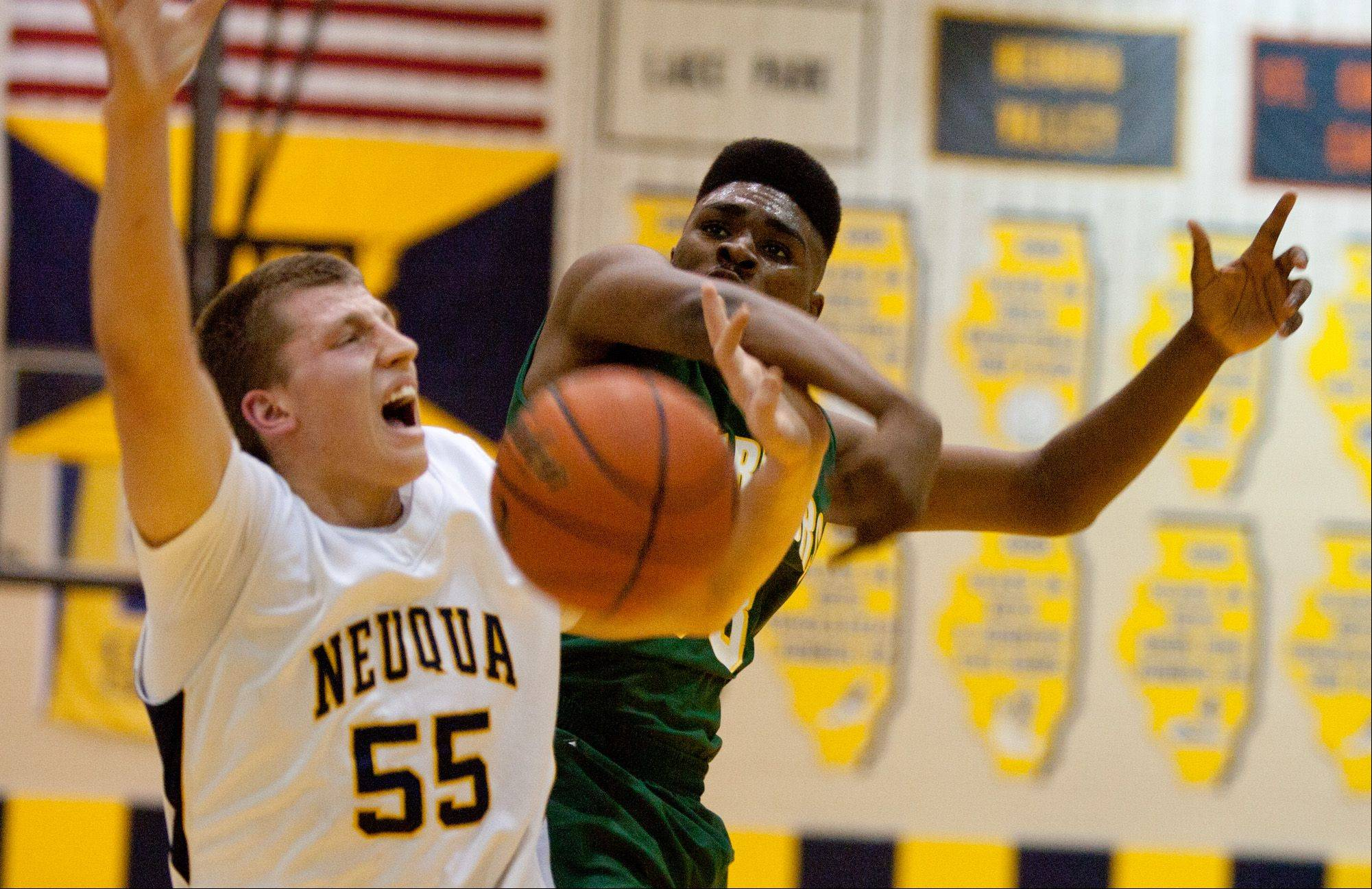Neuqua Valley's Pat Kenny, 55, has his shot blocked by Waubonsie Valley's Javares Stewart.