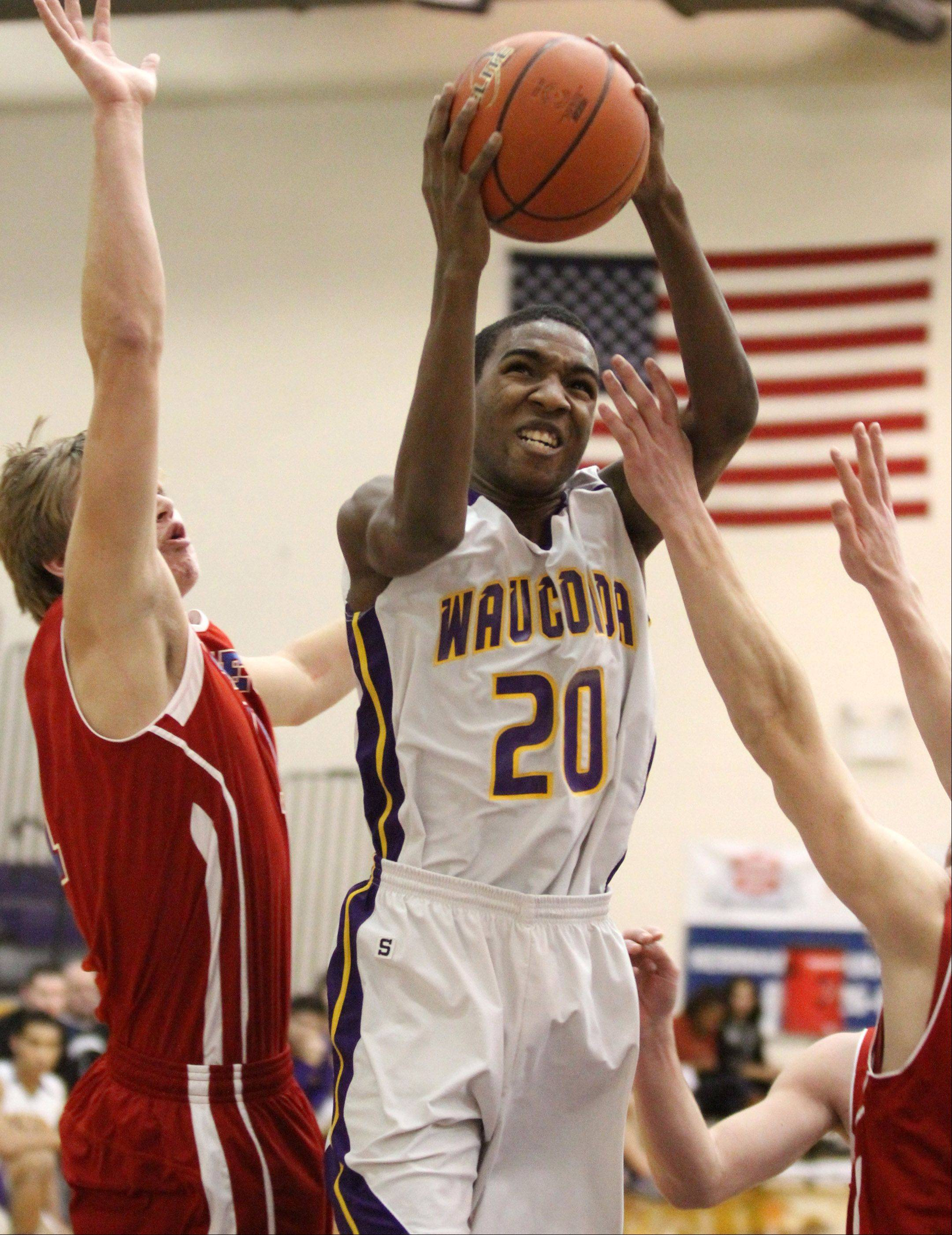 Wauconda's Devon Kings puts the ball up against a Lakes' defender at Wauconda on Friday.