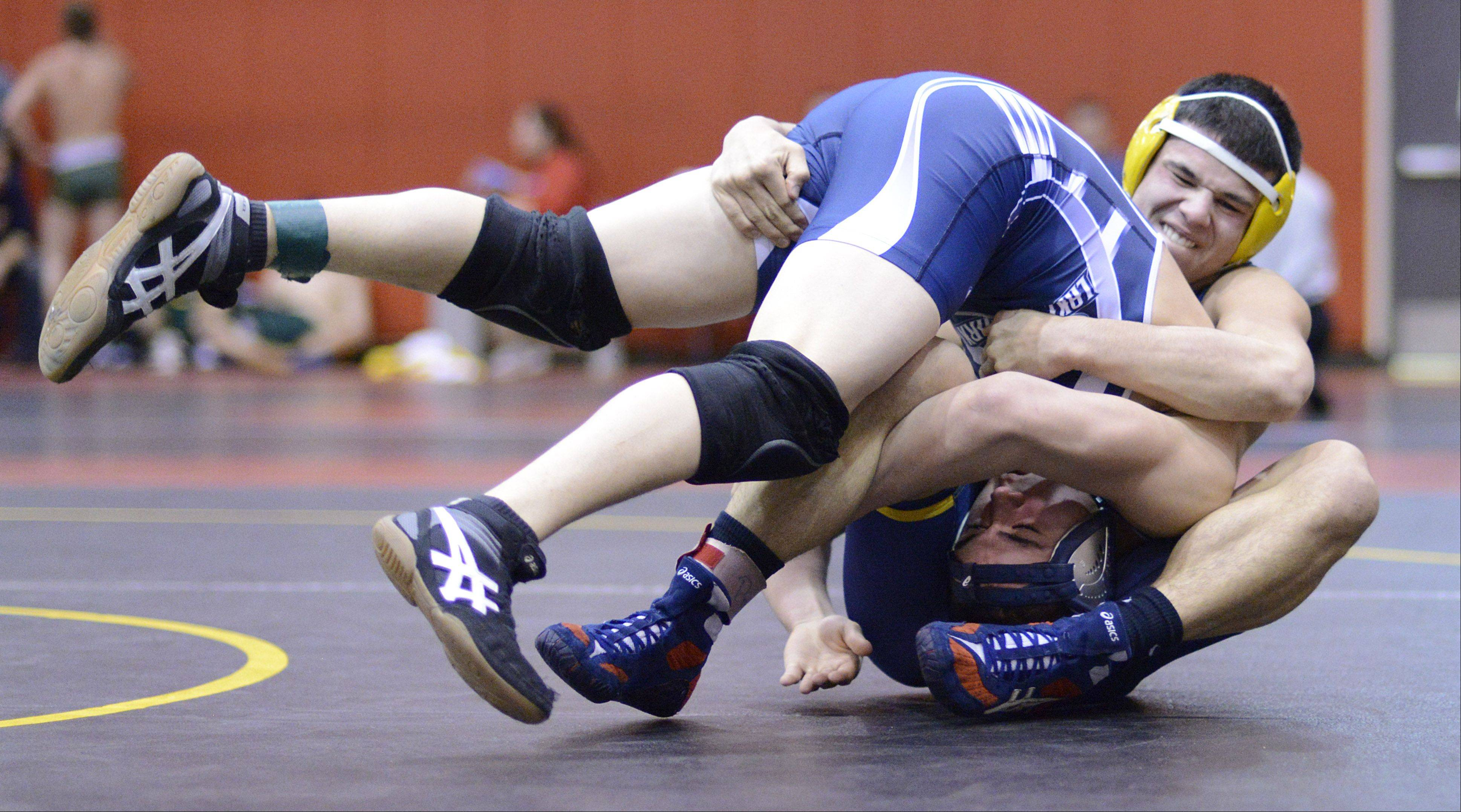 Neuqua Valley's Brent Lindenman and Lake Park's Henry Stoever wrestle in the 170-pound match Saturday.