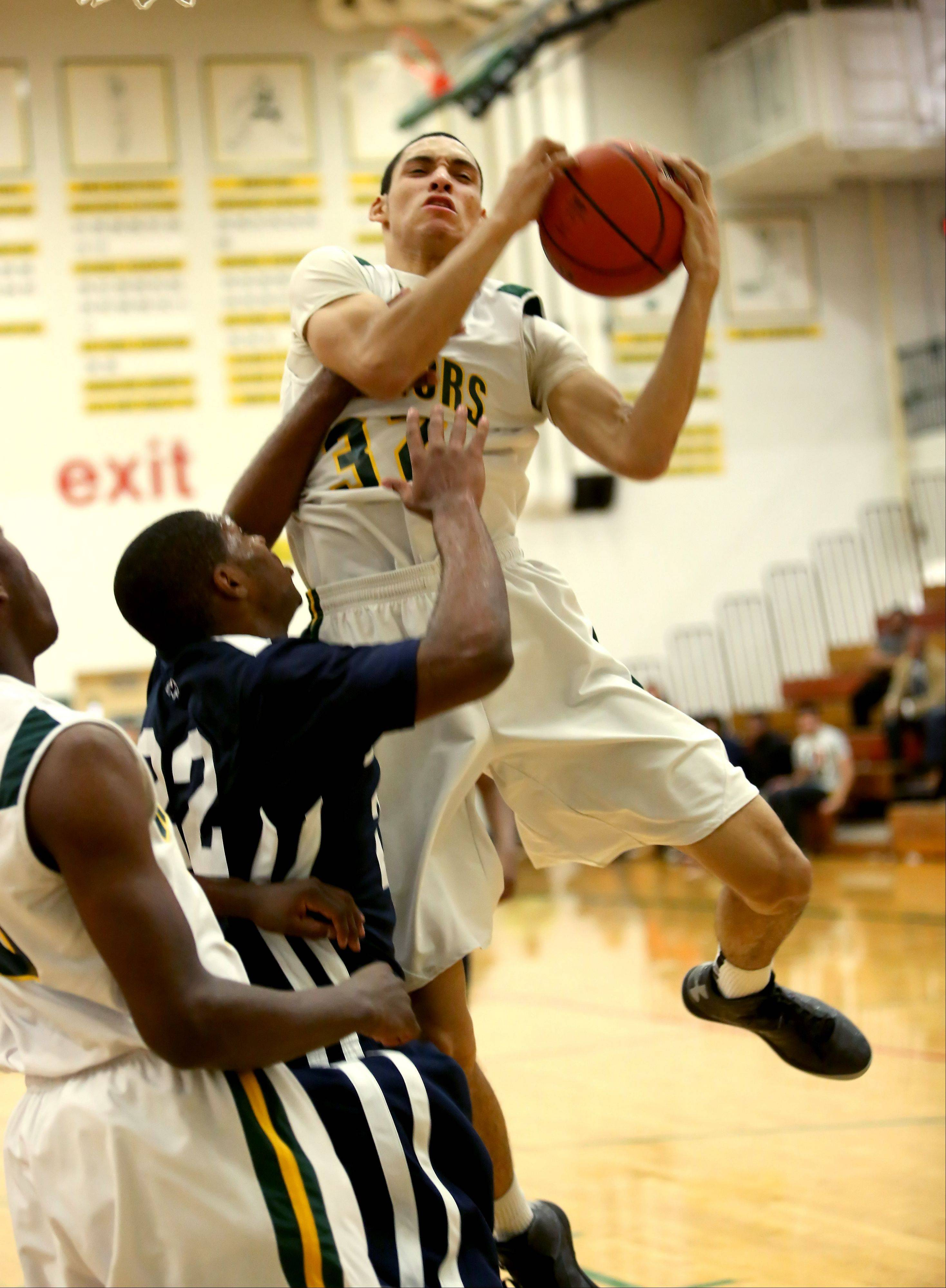 Waubonsie Valley's Bryan Jefferson goes for the rebound against Plainfield South during Tuesday's game in Aurora.