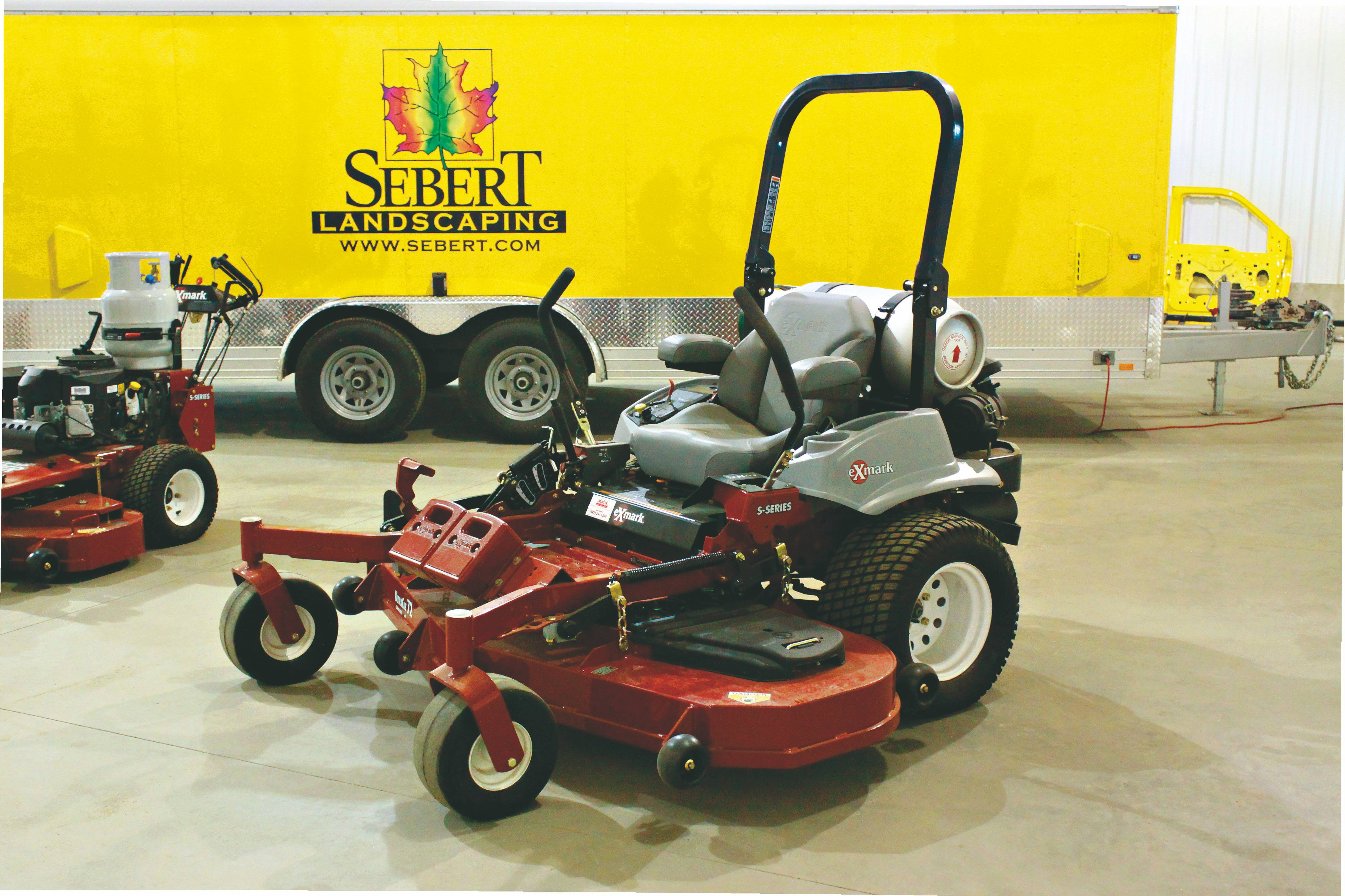 Sebert Landscaping's propane mowers and solar-powered trailer were among the reasons the company won two national environmental awards.