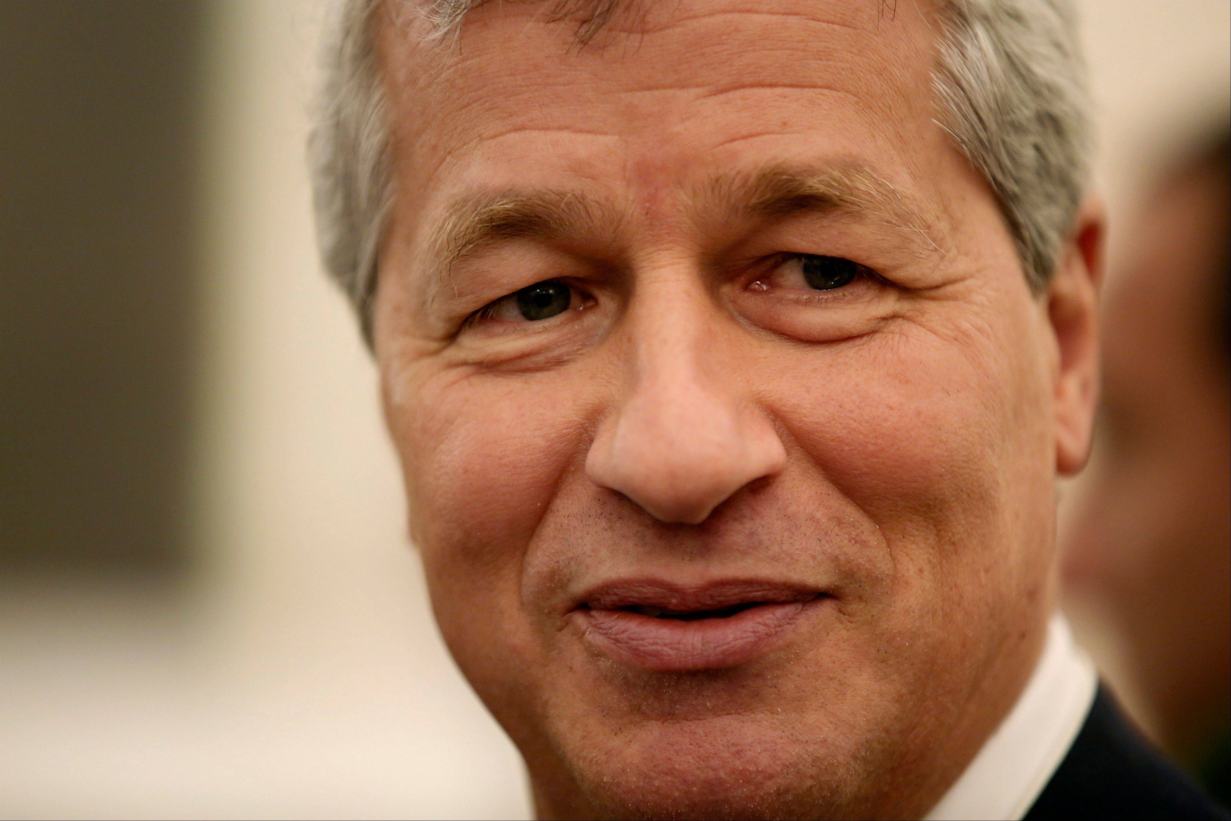James �Jamie� Dimon, chief executive officer of JPMorgan Chase & Co., speaks to an attendee before a panel discussion on the opening day of the World Economic Forum (WEF) in Davos, Switzerland, Wednesday.