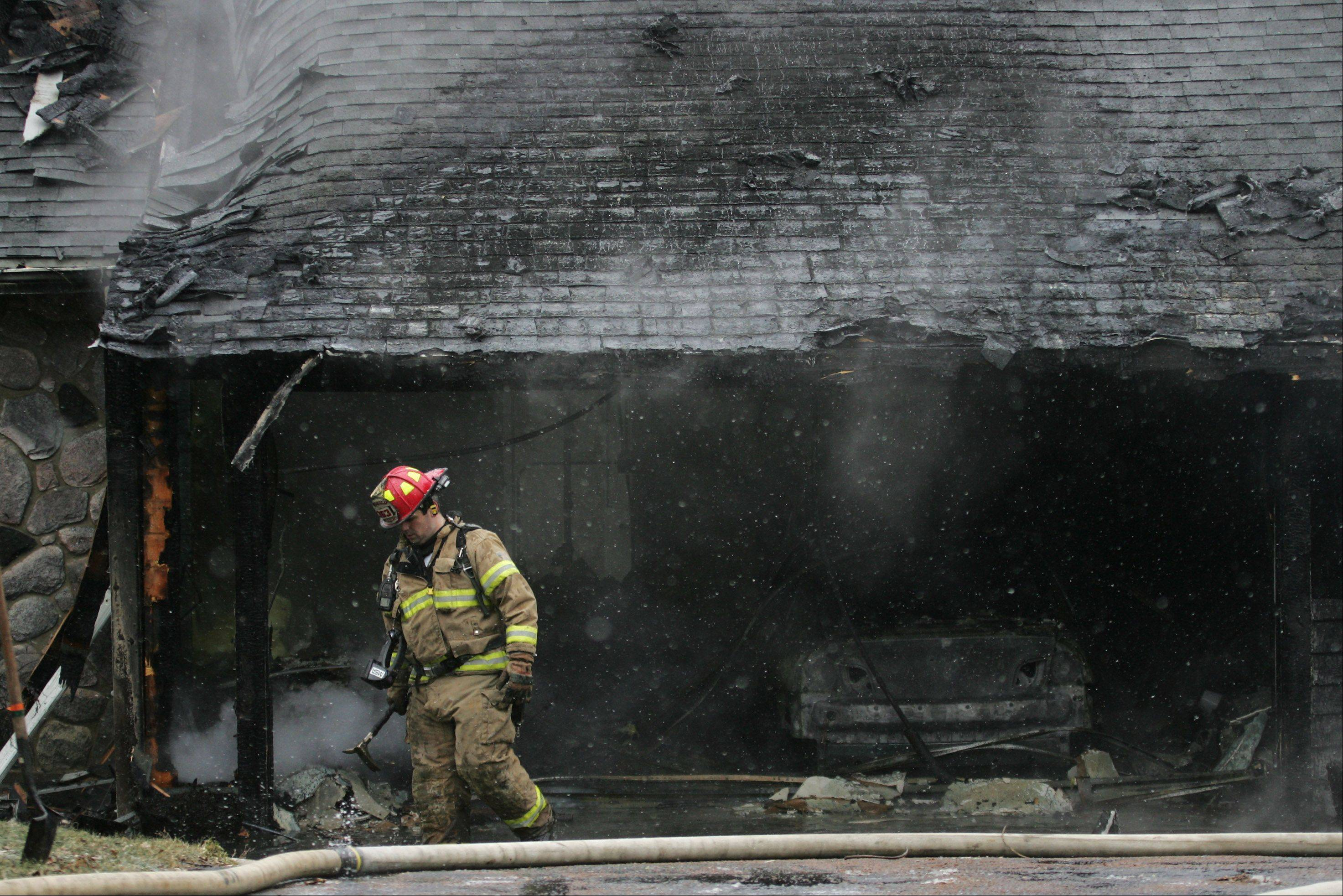 Firefighters battled a house fire Wednesday on the 26700 block of North Main Street in Wauconda. No one was injured in the fire that started in the garage and required assistance from 15 fire departments from Lake, Cook and McHenry counties.
