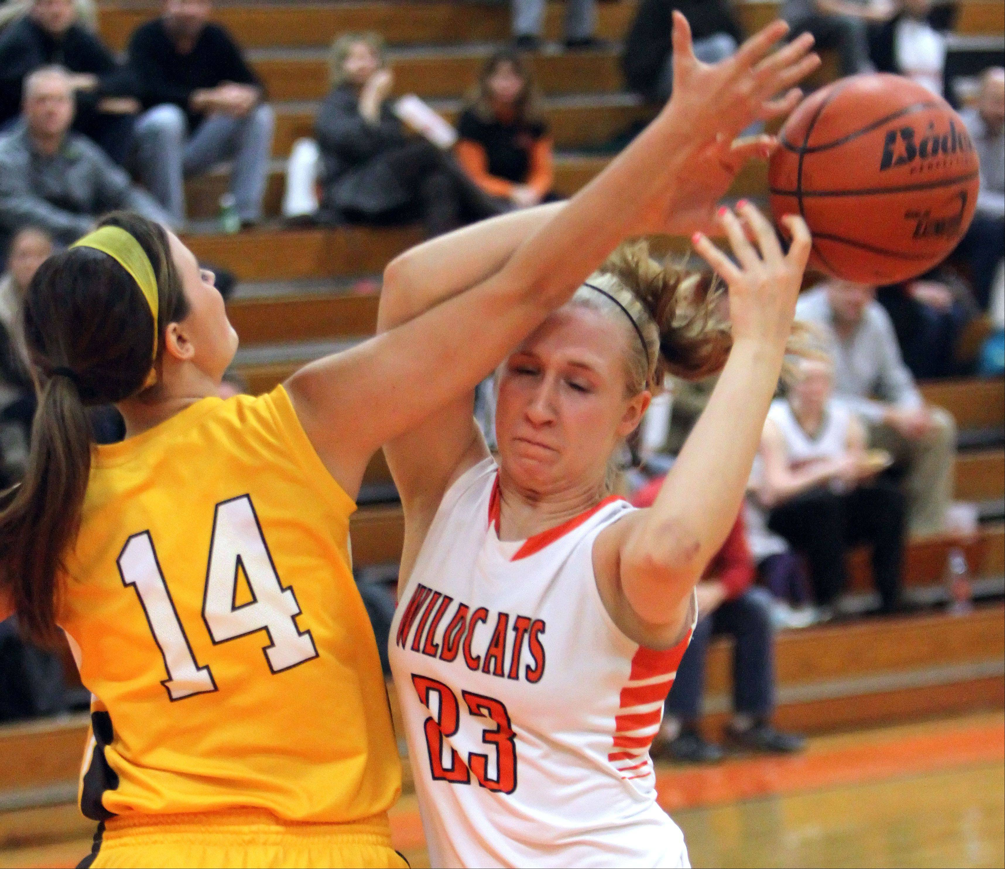 Libertyville�s Dana Kym, right, and Carmel�s Cassidy Kloss battle for a rebound.