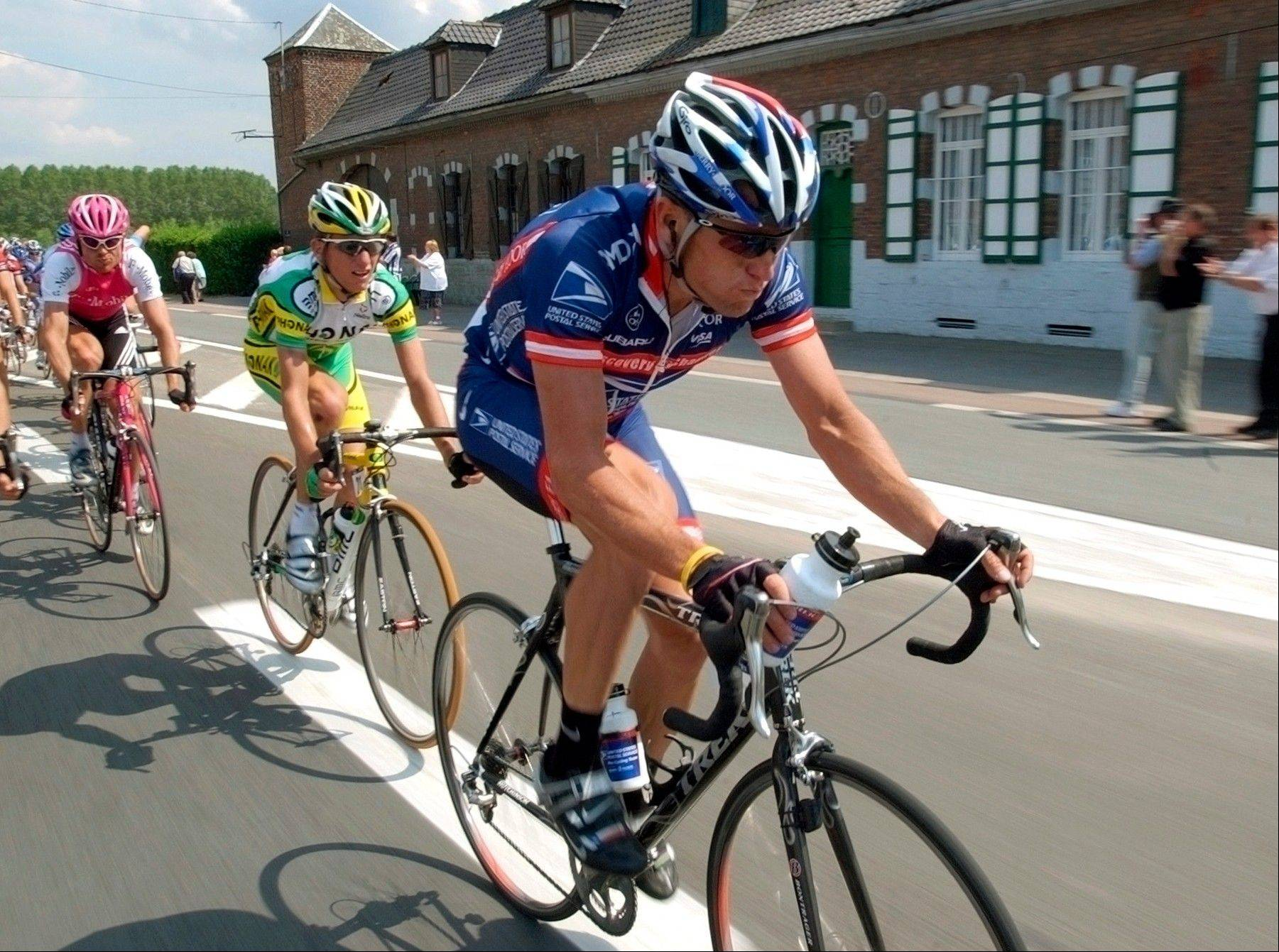 In this July 6, 2004, file photo, U.S. Postal Service�s Lance Armstrong rides ahead of Team Phonak�s Tyler Hamilton, center, and T-Mobile�s Jan Ullrich, of Germany, during the third stage of the Tour de France cycling race. Former International Cycling Union president Hein Verbruggen defended the governing body�s doping policy during the Lance Armstrong era, and said it acted appropriately when it informed riders about suspicious test results.