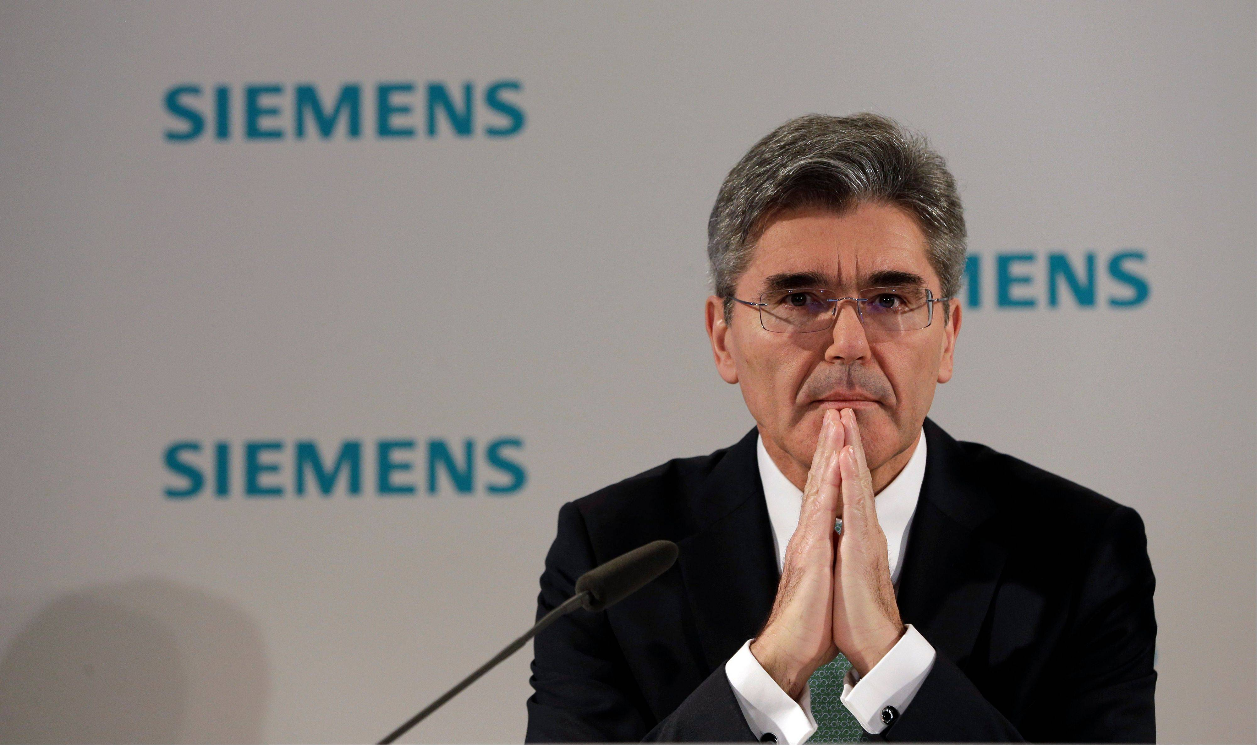 Joe Kaeser, CFO of German industrial conglomerate Siemens, gestures during a news conference prior to the annual shareholder meeting in Munich, southern Germany Wednesday.