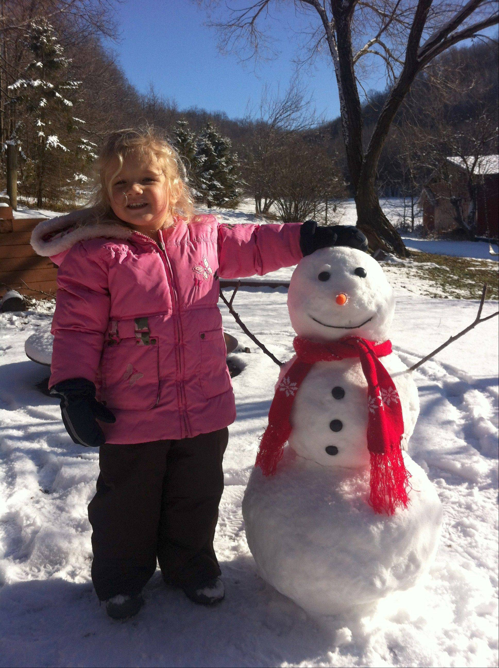 Whisked away from the hustle of busy lives, families staying at Candlewood Cabins in southwest Wisconsin can take time for simple pleasures like building snowmen.
