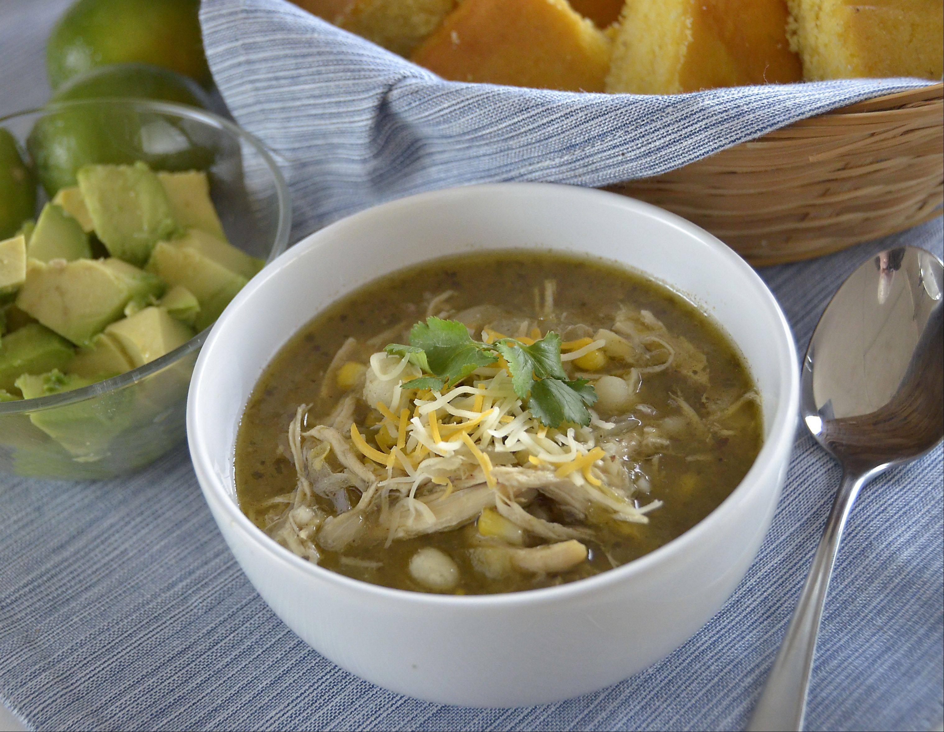 Convenience foods like supermarket roasted chicken and frozen corn help this chicken chili come together relatively quick and still boast bowls full of flavor.