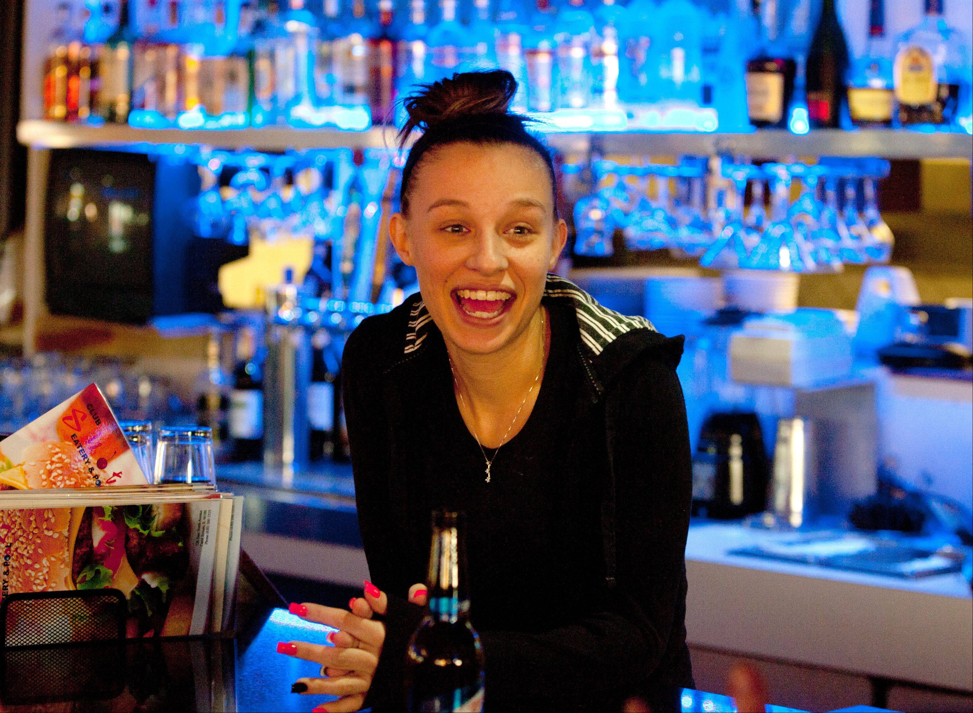 Ashley Edminson tends bar at Club Shotz in Carol Stream.