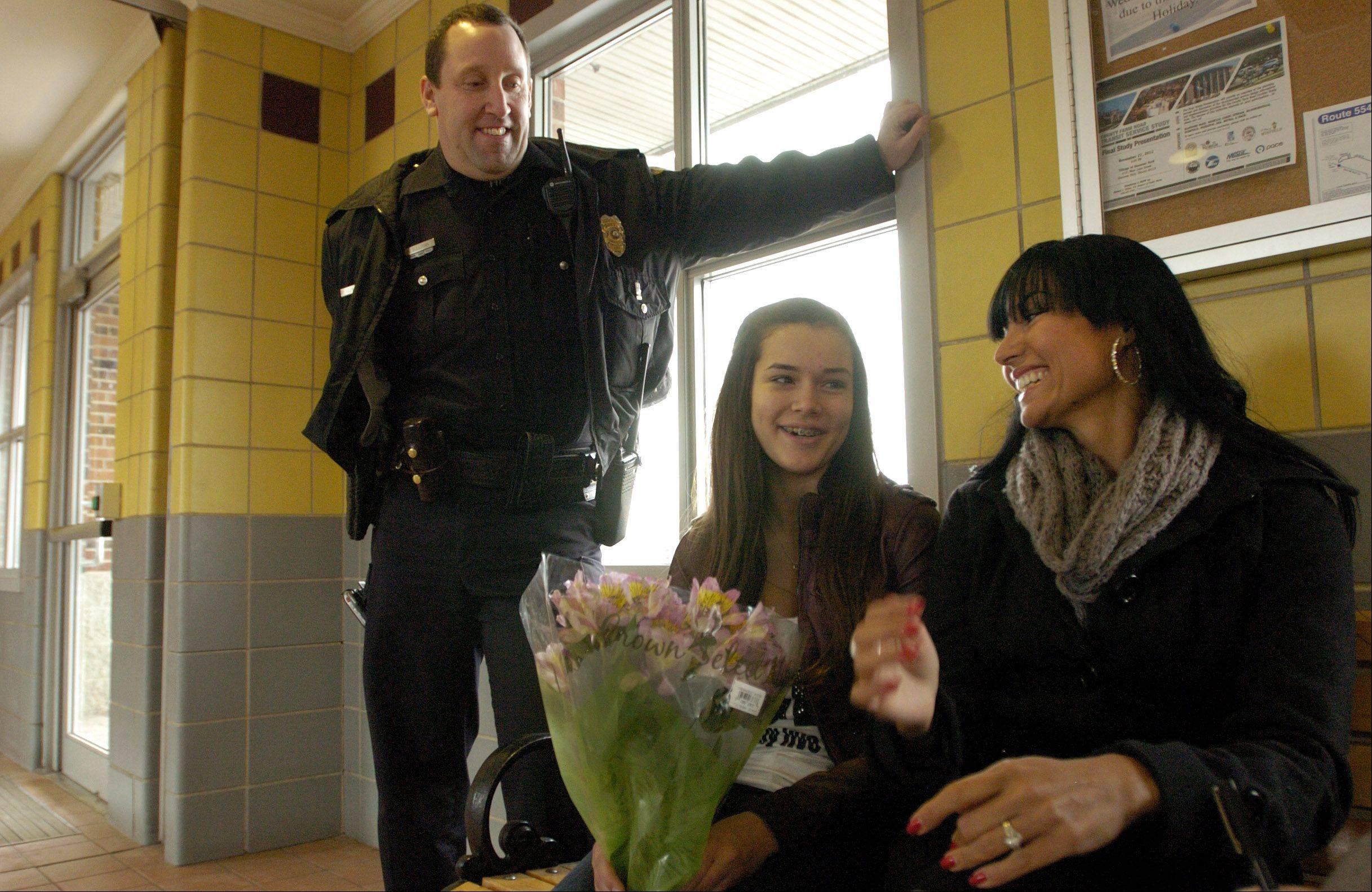 Hanover Park police Officer George Sullivan reunites with Brianna Elizondo and her mom, Monica Bakos, 13 years after delivering Brianna in the Hanover Park Metra station parking lot.