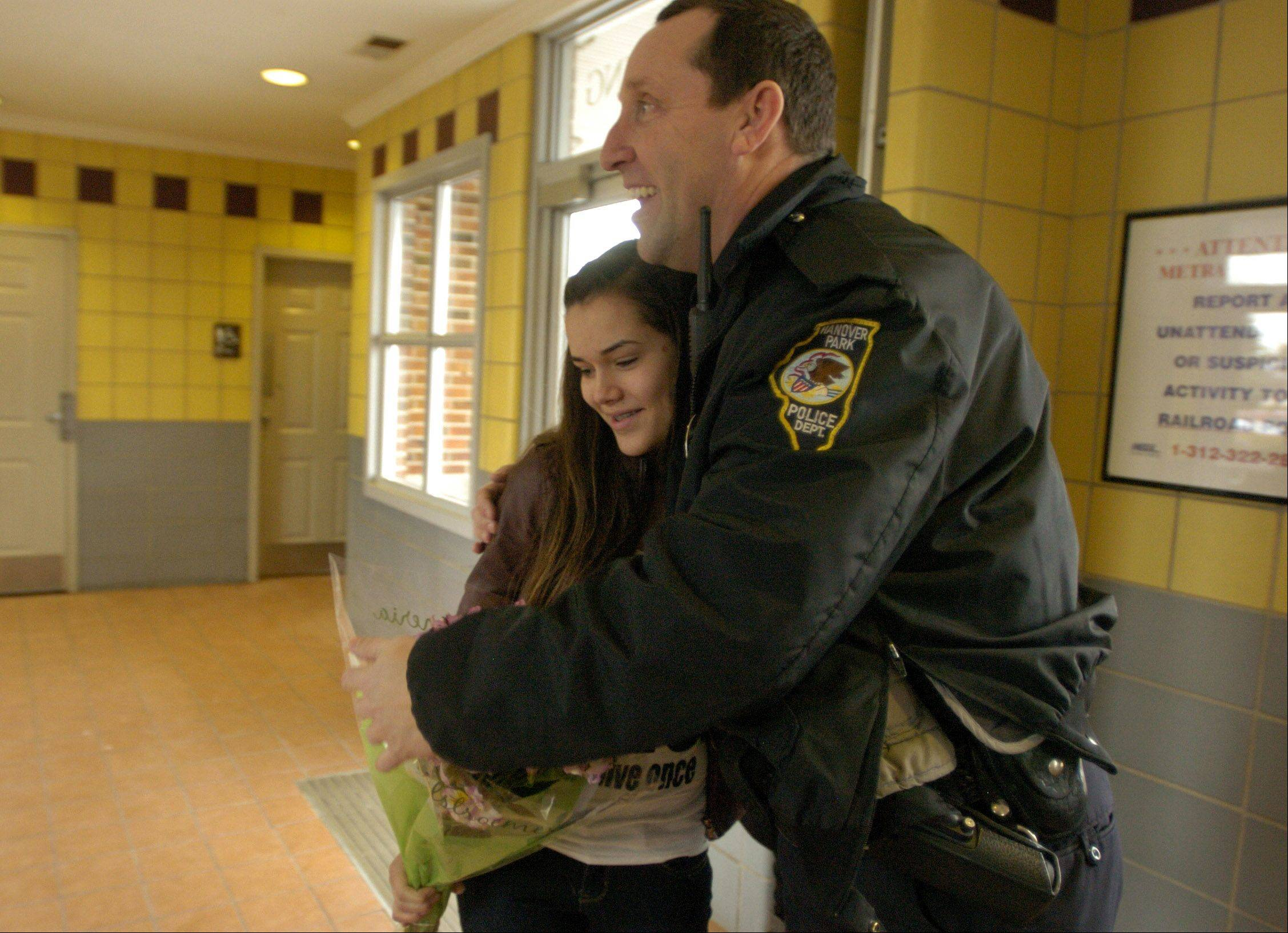 Hanover Park police Officer George Sullivan reunites with Brianna Elizondo, whom he helped deliver 13 years ago in the Hanover Park Metra station parking lot.