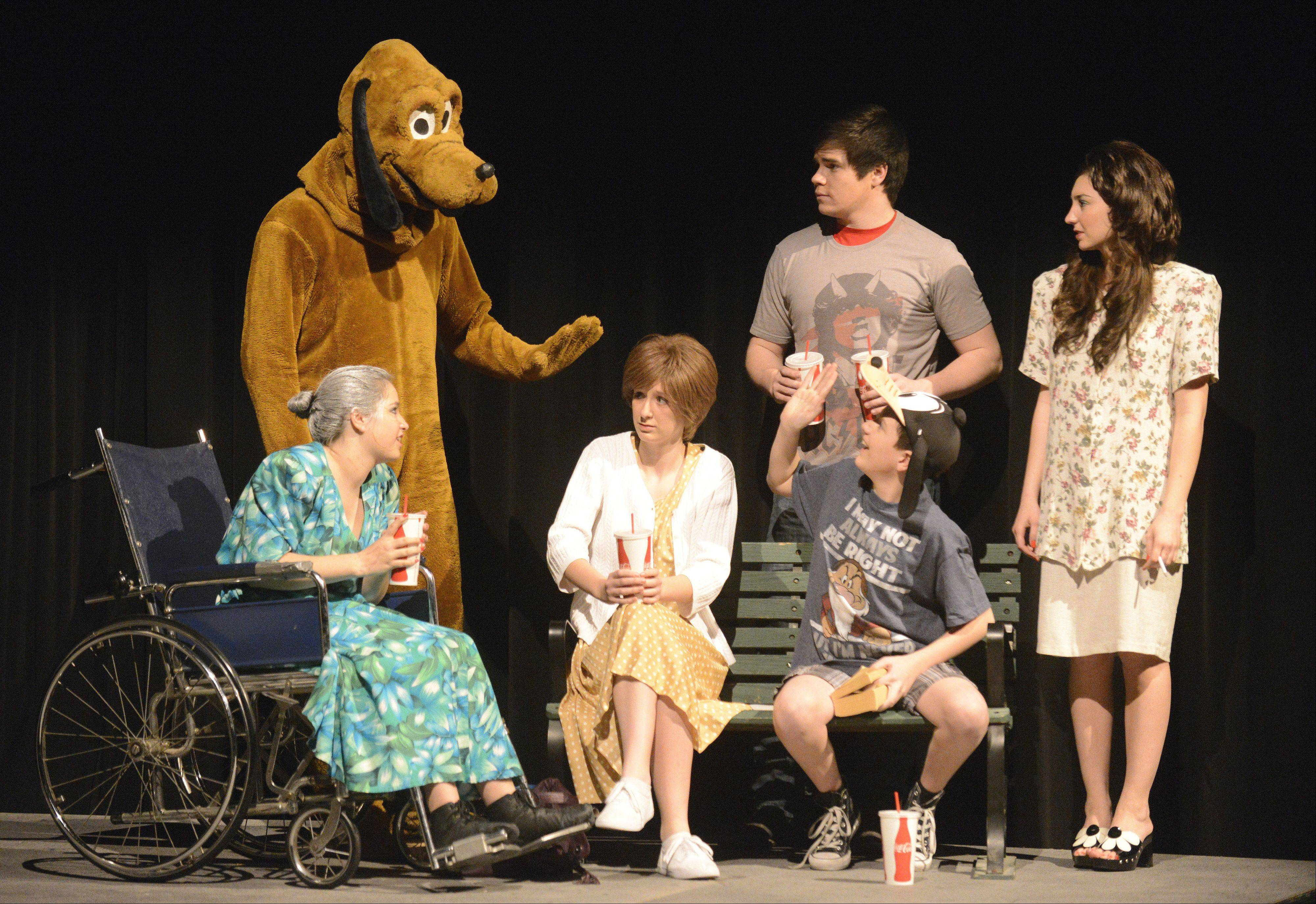"Charlie waves at Pluto as the family visits Disneyland in Batavia High School's presentation of ""Marvin's Room."" From left are Claire Heronemus, 17, as Ruth; Mitch Wallfred, 18, as Pluto; Kelsey Skomer, 17 as Bessie; John Hohman, 14, as Charlie (seated); Jake Birkhaug, 16, as Hank; and Jordan Morgan, 16 as Lee."