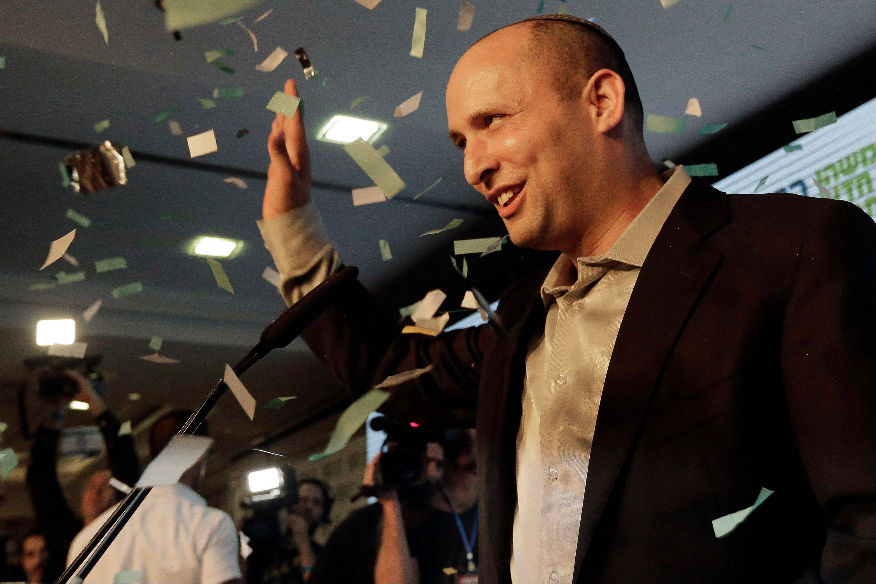 Naftali Bennett, head of Israel's Jewish Home party, greets his supporters at the party's headquarters in the city of Ramat Gan, Israel Tuesday, Jan. 22, 2013. Prime Minister Benjamin Netanyahu and his hard line allies fared worse than expected in a parliamentary election Tuesday, preliminary results showed, possibly forcing him to reach across the aisle and court a popular political newcomer to cobble together a new coalition.