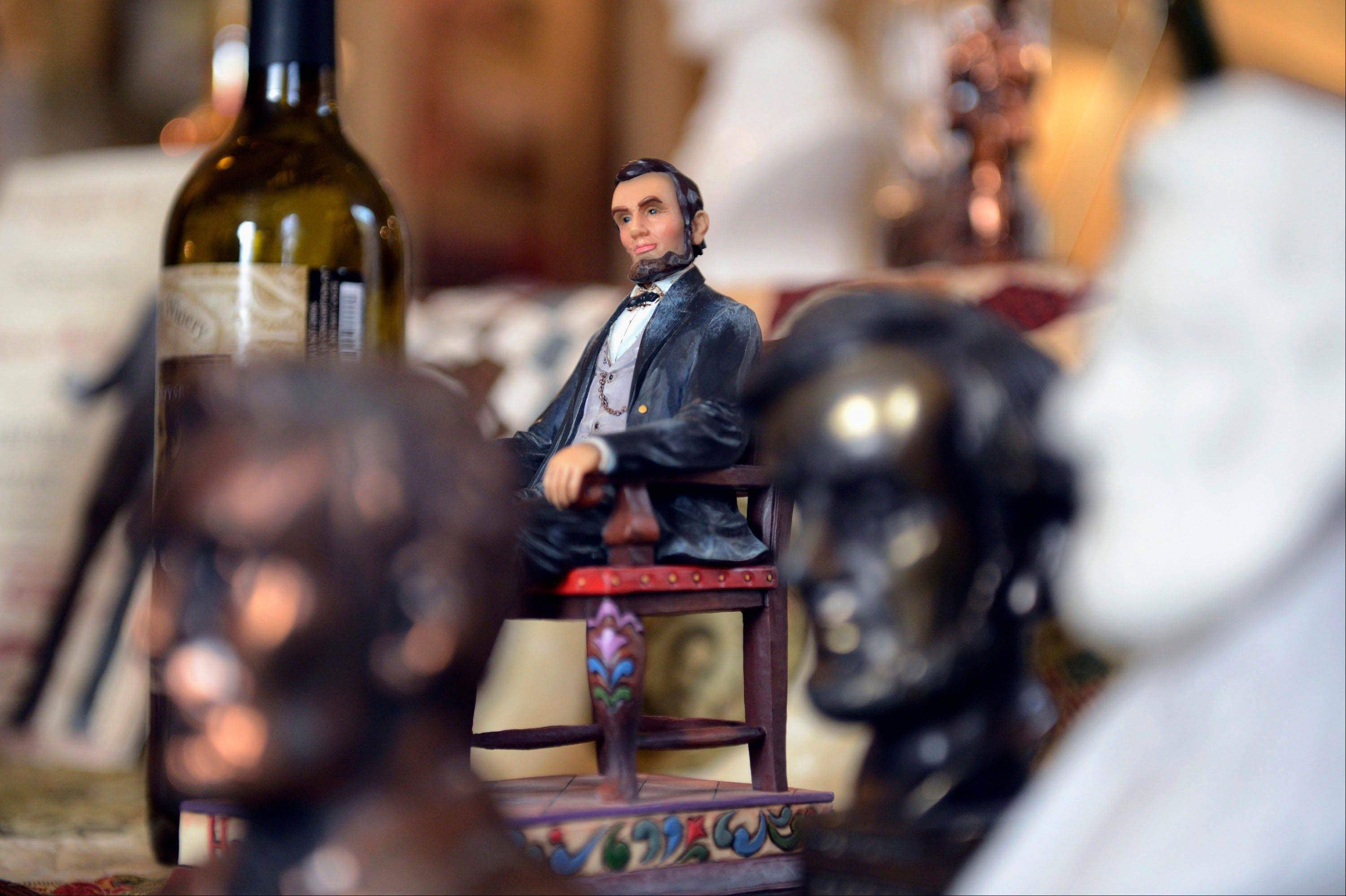 "Items for the exhibit called ""Lincoln's Image, Commanding, Comical & Kitsch: From the Utilitarian and Collectible to the Common and Cheesy"" at the Metamora Courthouse State Historic Site in Metamora."