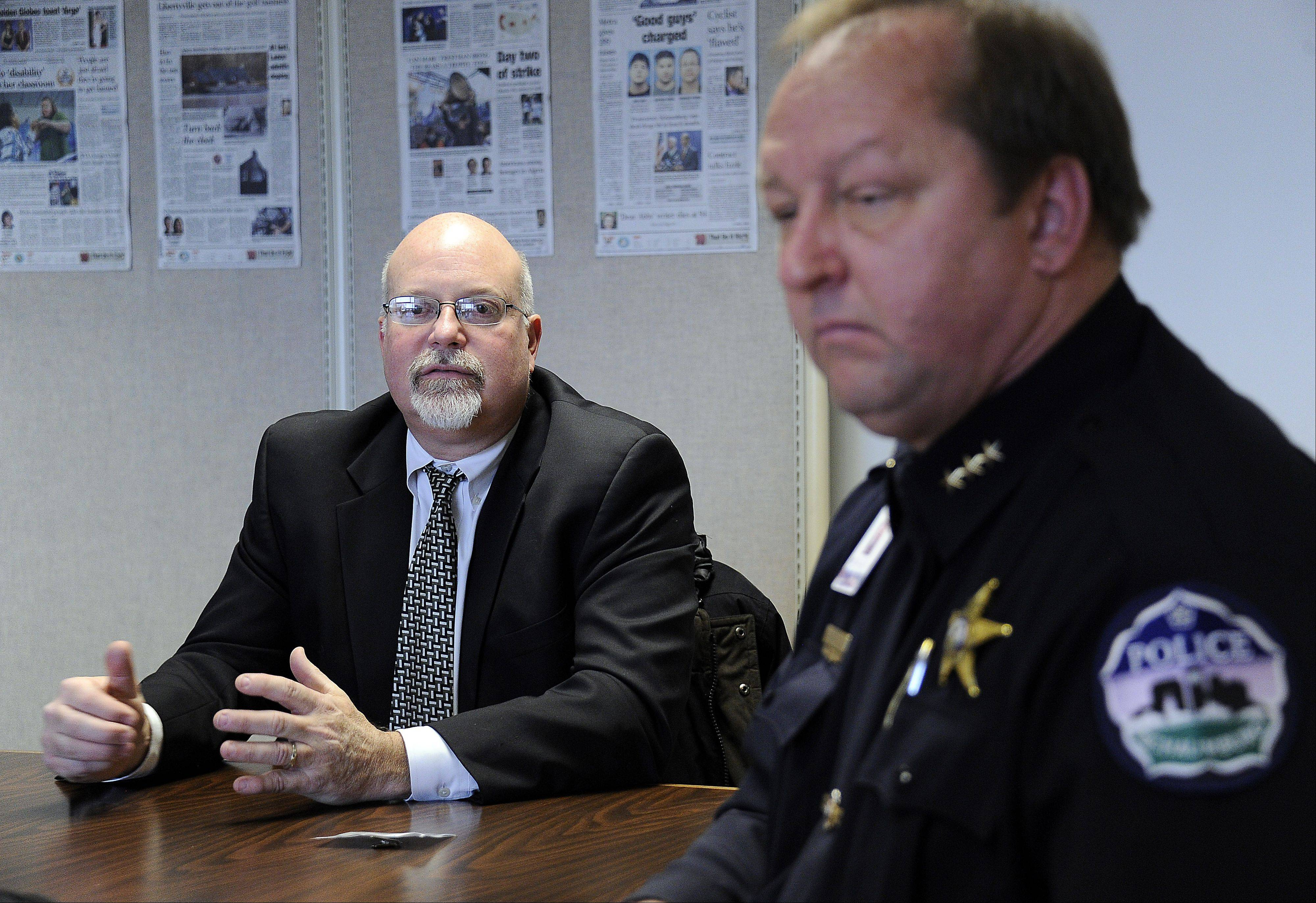 Schaumburg Village Manager Ken Fritz talks to the Daily Herald editorial board as Schaumburg Police Chief Brian Howerton listens Tuesday during a discussion of last week's arrests of three police officers on drug charges.