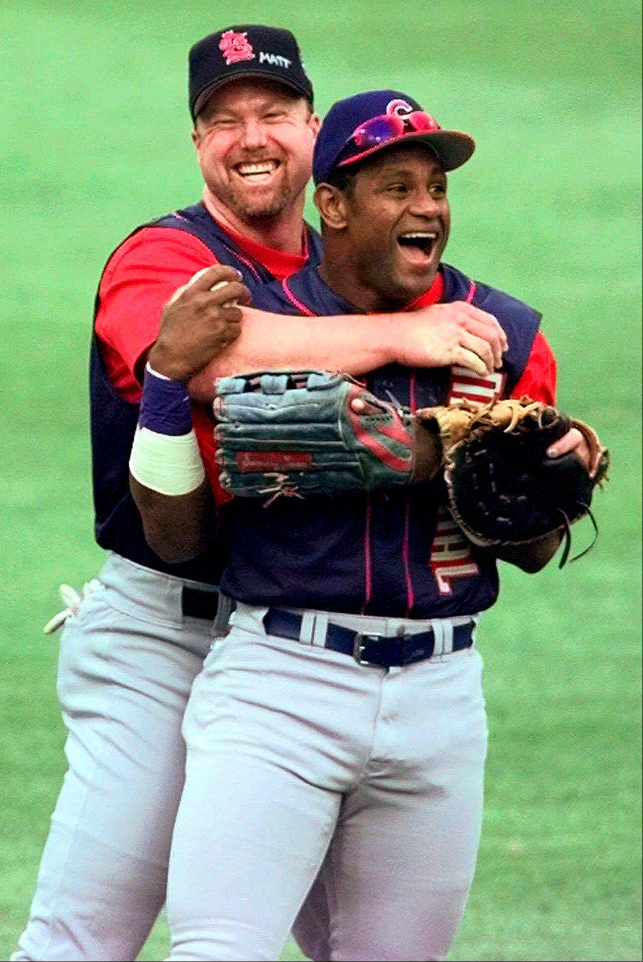 In this July 12, 1999, file photo, St. Louis Cardinals' Mark McGwire, left, hugs Chicago Cubs' Sammy Sosa in the outfield at Fenway Park during a workout for baseball's All-Star Game in Boston. In a Wednesday, Jan. 23, 2013, interview on the website Ustream.com, Sosa said that he thinks he and fellow steroid-tainted star McGwire belong in the Hall of Fame, that the Cubs should retire his number, and he left open the possibility of running for president of the Dominican Republic.