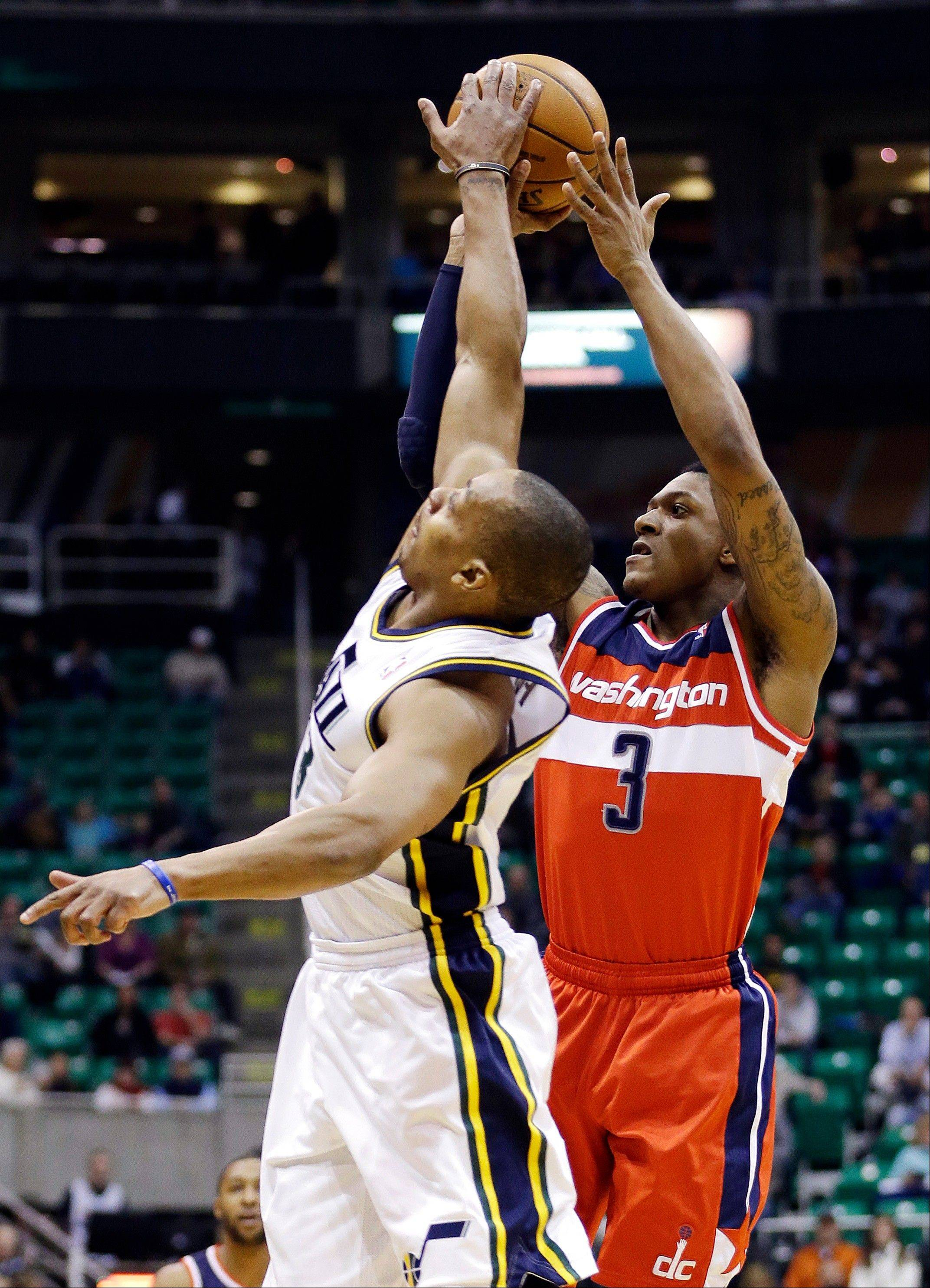 Utah Jazz's Randy Foye, left, blocks the shot of Washington Wizards' Bradley Beal (3) during the first quarter of an NBA basketball game, Wednesday, Jan. 23, 2013, in Salt Lake City.
