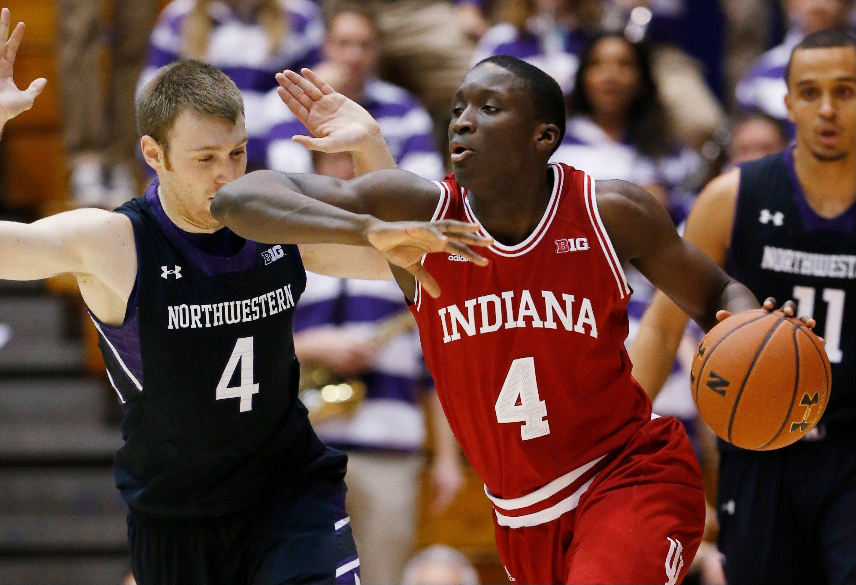 Indiana guard Victor Oladipo, front right, drives against Northwestern guard Alex Marcotullio during the second half of an NCAA college basketball game in Evanston, Sunday, Jan. 20, 2013. Indiana won 67-59.