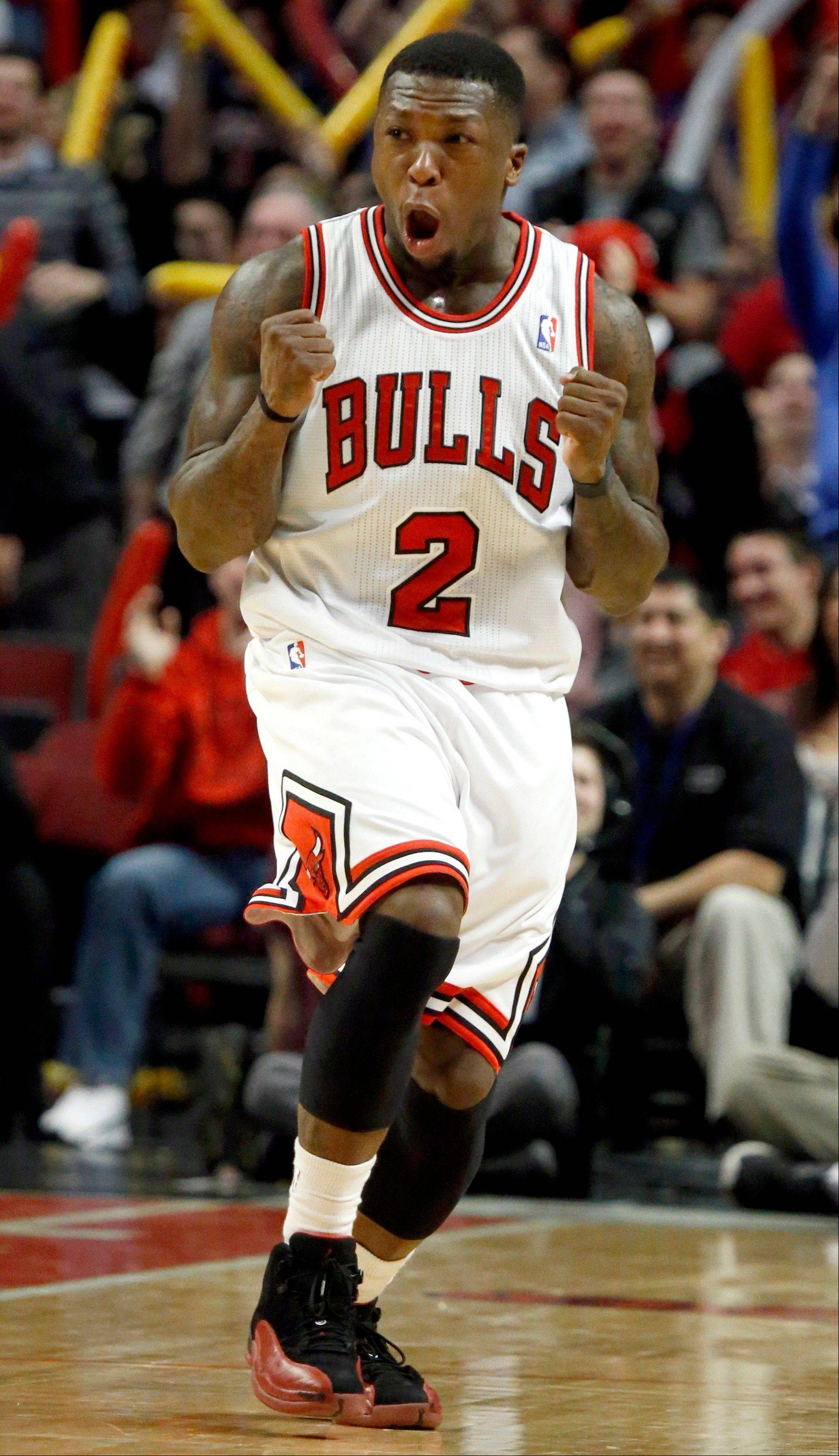 Chicago Bulls point guard Nate Robinson reacts during the second half of an NBA basketball game against the Detroit Pistons, Wednesday, Jan. 23, 2013, in Chicago. The Bulls won 85-82.
