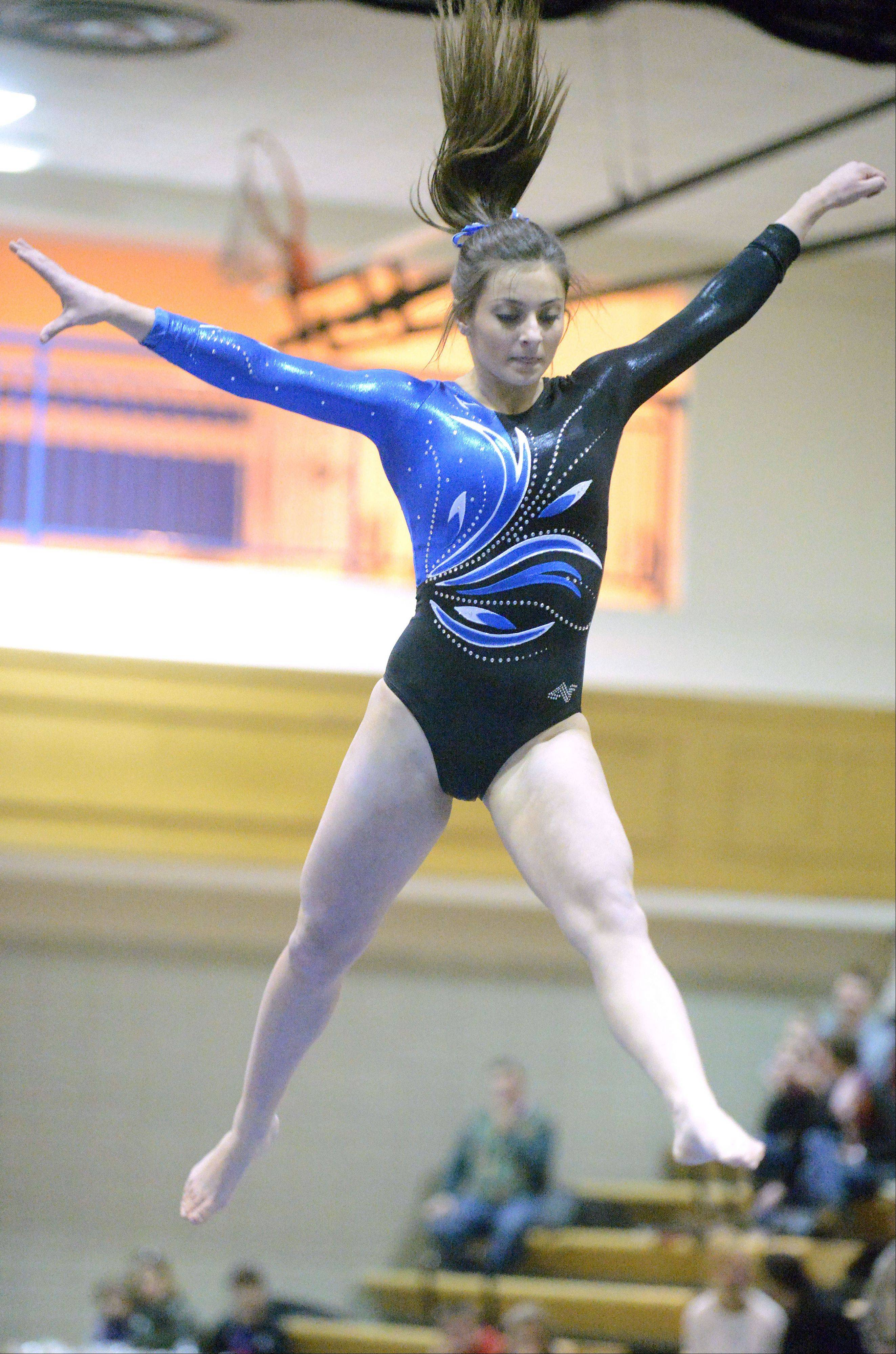 Geneva's Dominque Brognia performs her beam routine on Wednesday, January 23.