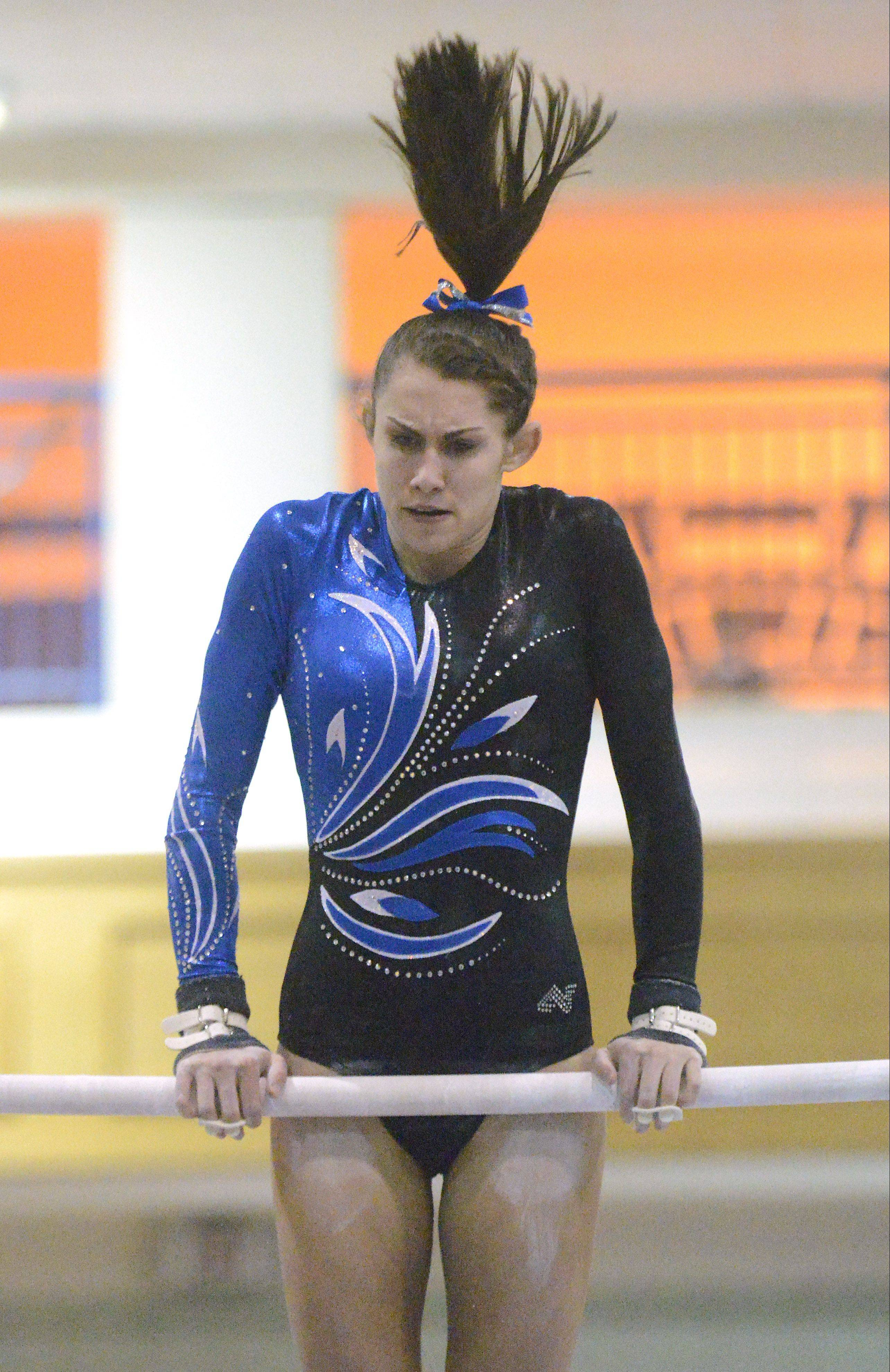 Geneva's Ashley Puff performs her bars routine on Wednesday.