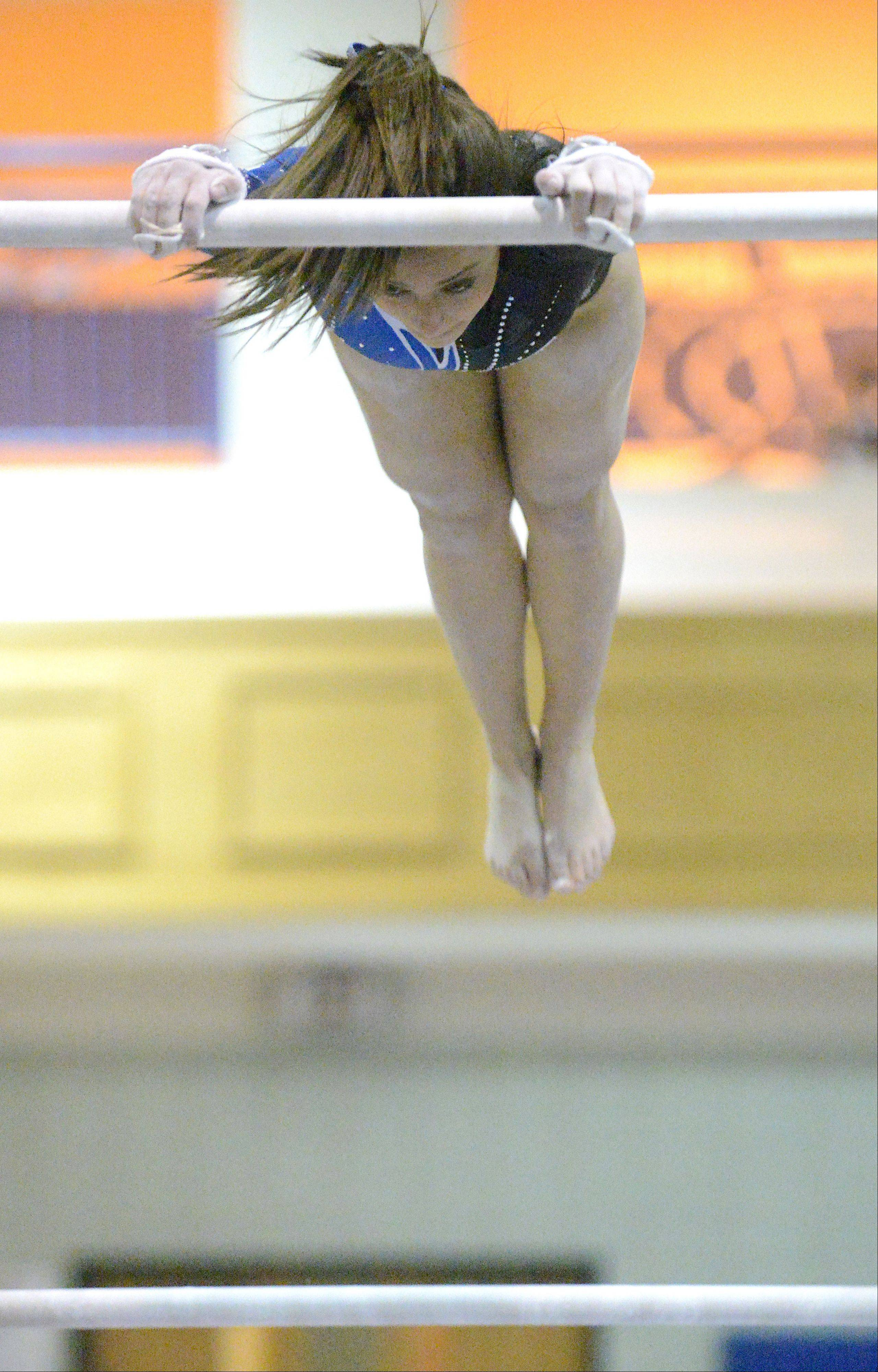Geneva's Dominque Brognia performs her bars routine on Wednesday, January 23.