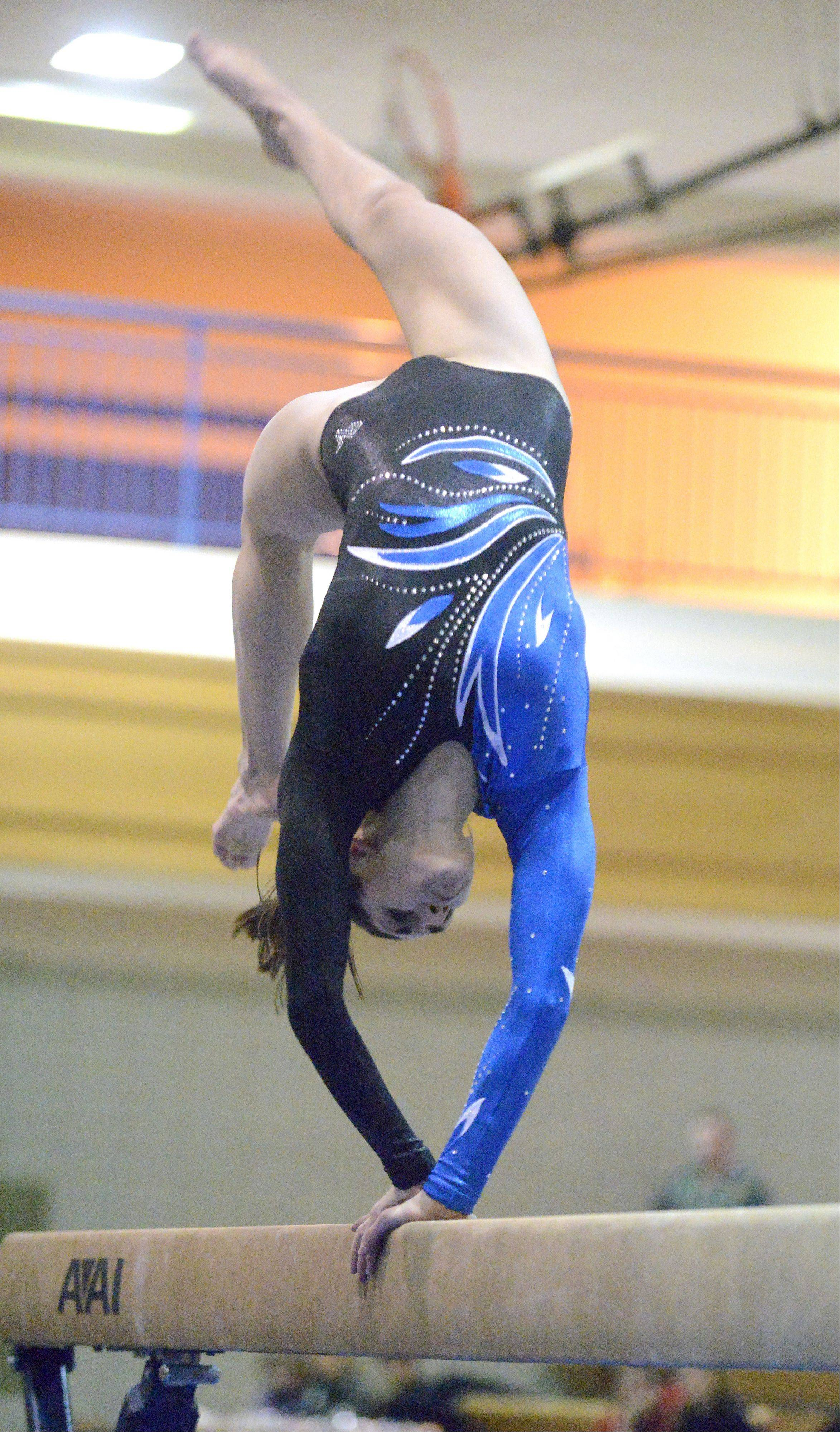 Geneva's Ashley Puff performs her beam routine on Wednesday, January 23.