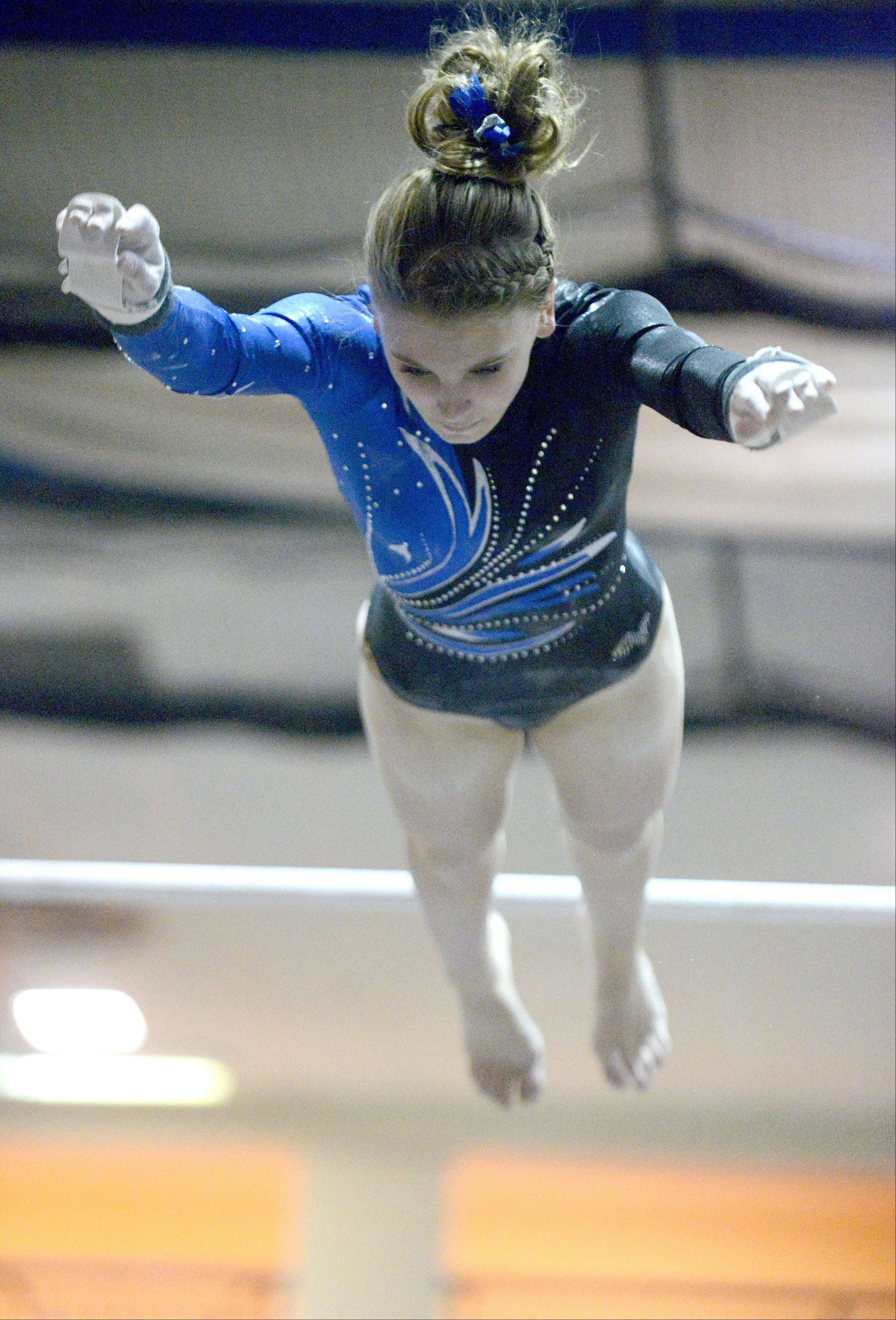 Geneva's Megan Beitzel dismounts from the bars at the end of her routine on Wednesday, January 23.