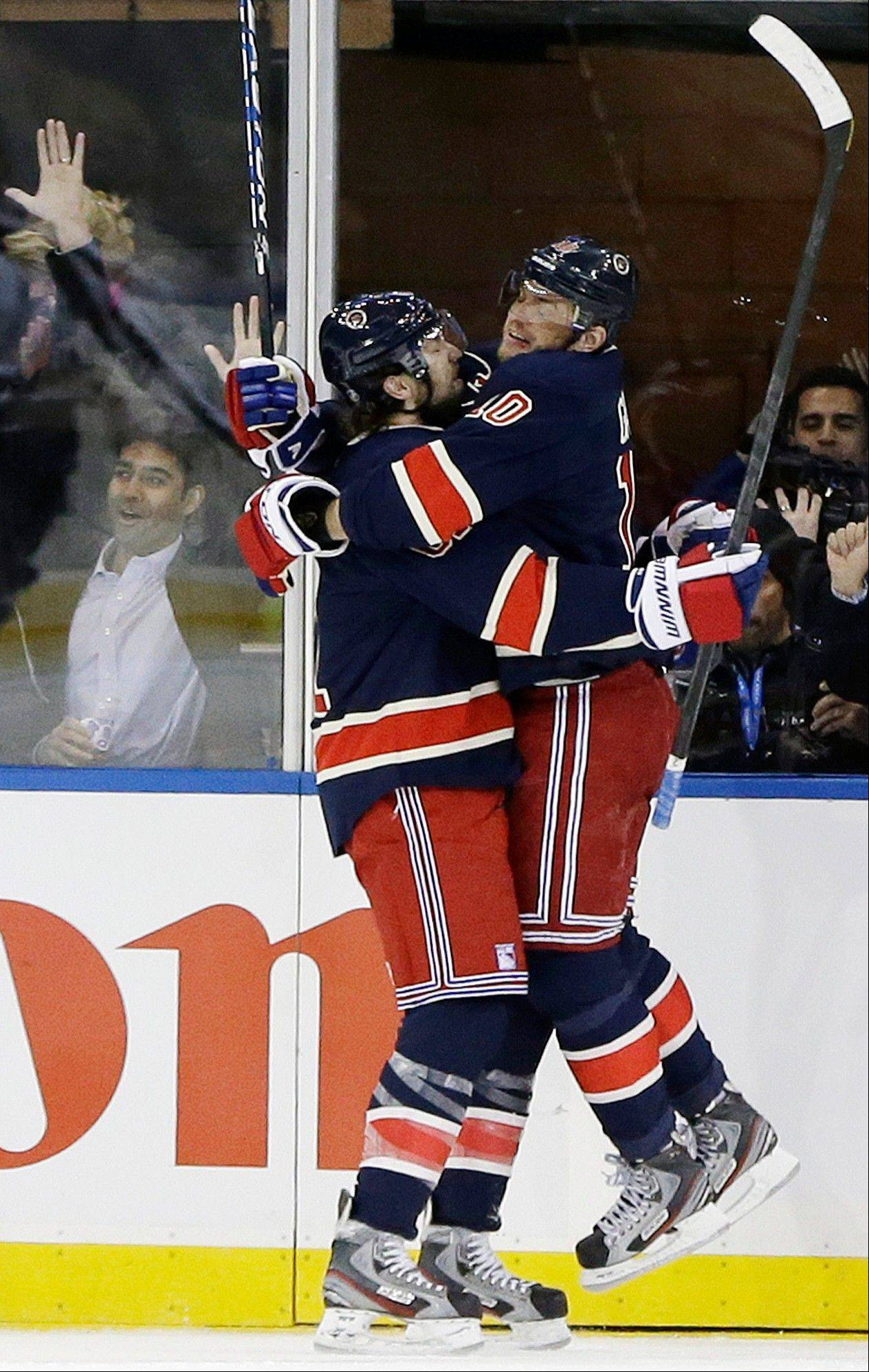 New York Rangers left wing Rick Nash (61) celebrates with New York Rangers right wing Marian Gaborik (10) after Gaborik scored a goal in the first period of their NHL hockey game at Madison Square Garden in New York, Wednesday, Jan. 23, 2013. Gaborik scored two goals in the period.