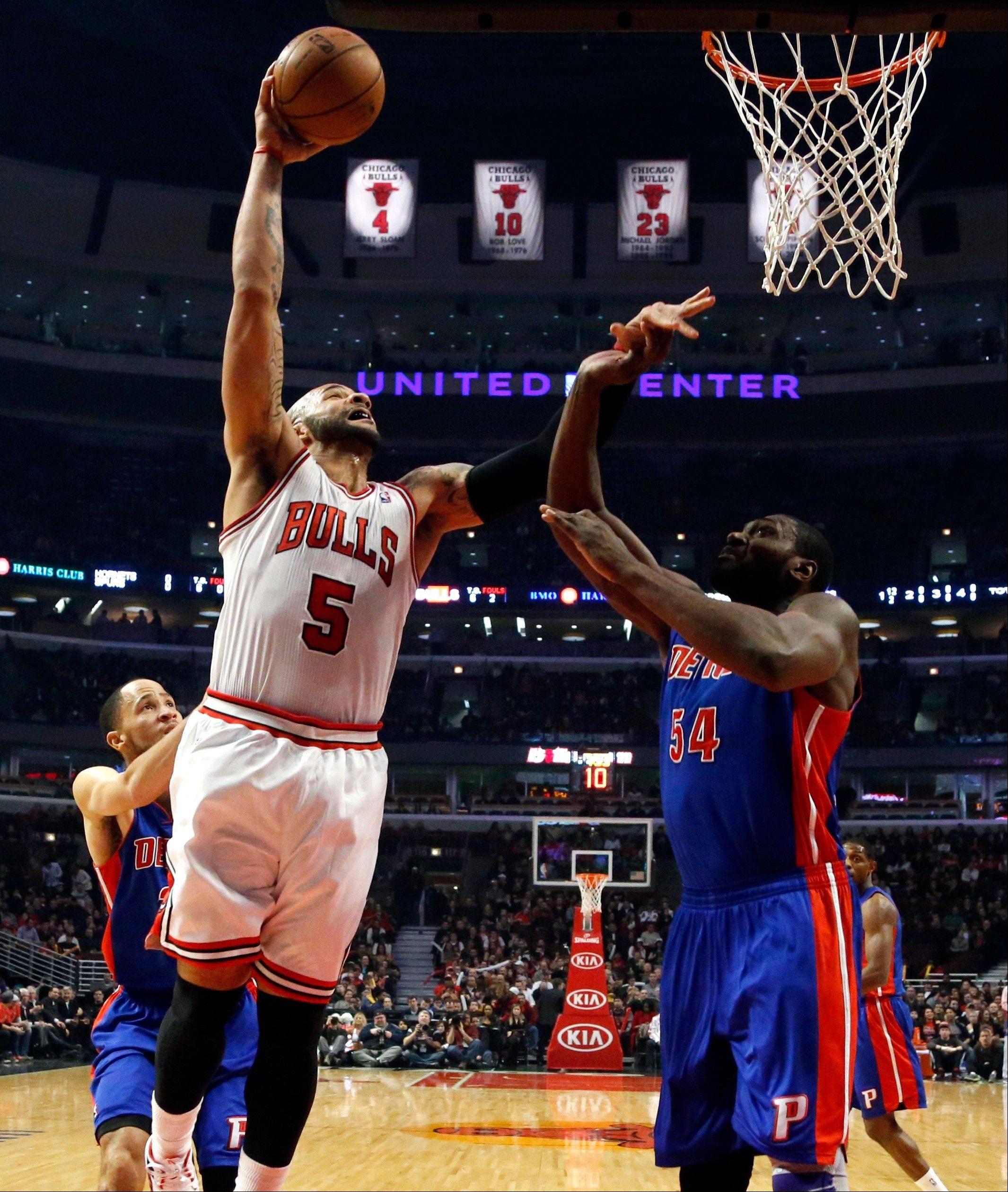 Chicago Bulls forward Carlos Boozer (5) shoots over Detroit Pistons forward Jason Maxiell (54) during the first half of an NBA basketball game, Wednesday, Jan. 23, 2013, in Chicago. Boozer could be namedwhen the NBA's all-star reserves are announced Thursday on TNT, starting a 6 p.m.