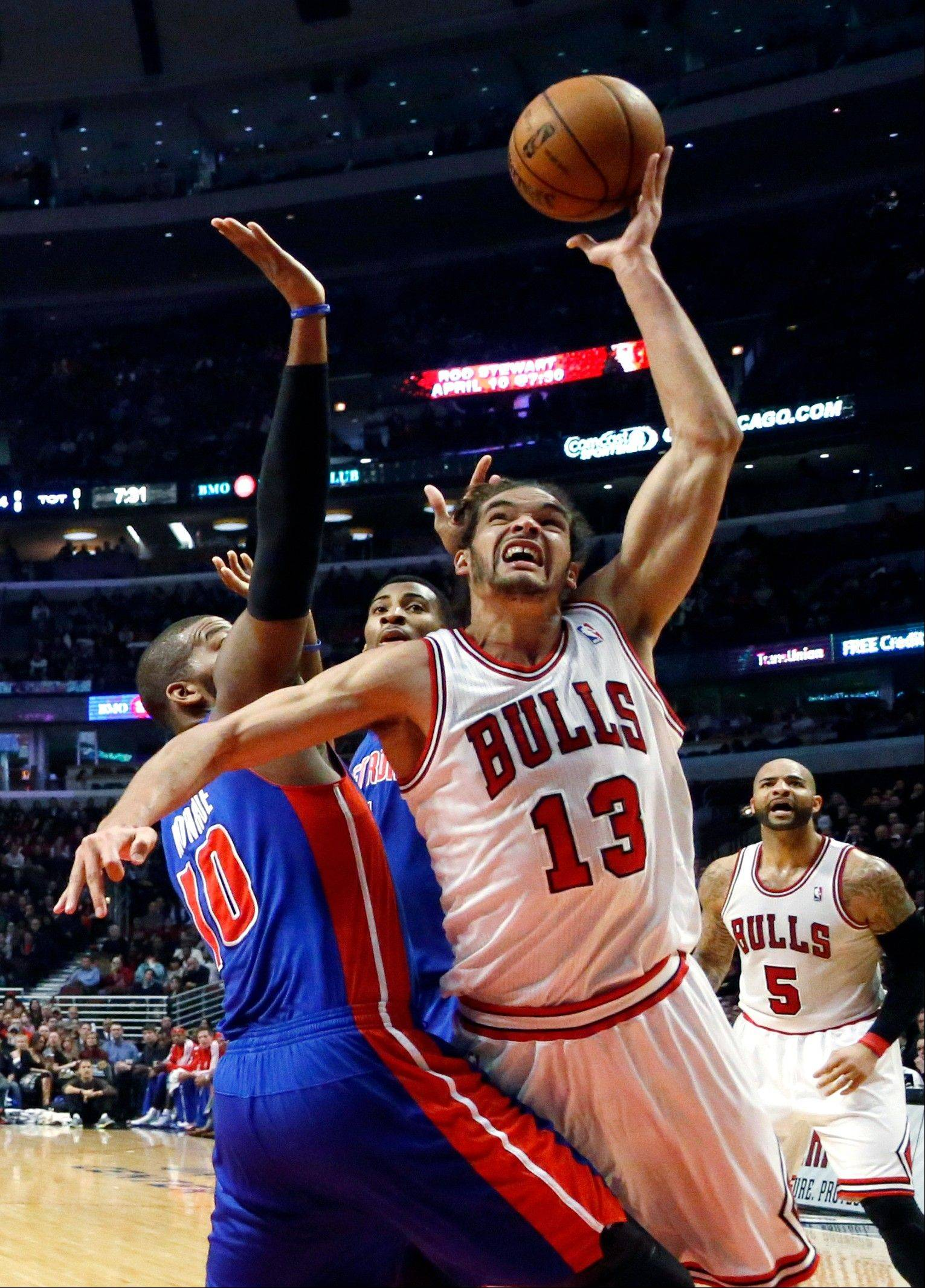 Chicago Bulls center Joakim Noah (13) shoots over Detroit Pistons center Greg Monroe (10) during the first half of an NBA basketball game, Wednesday, Jan. 23, 2013, in Chicago. Noah could be namedwhen the NBA's all-star reserves are announced Thursday on TNT, starting a 6 p.m.