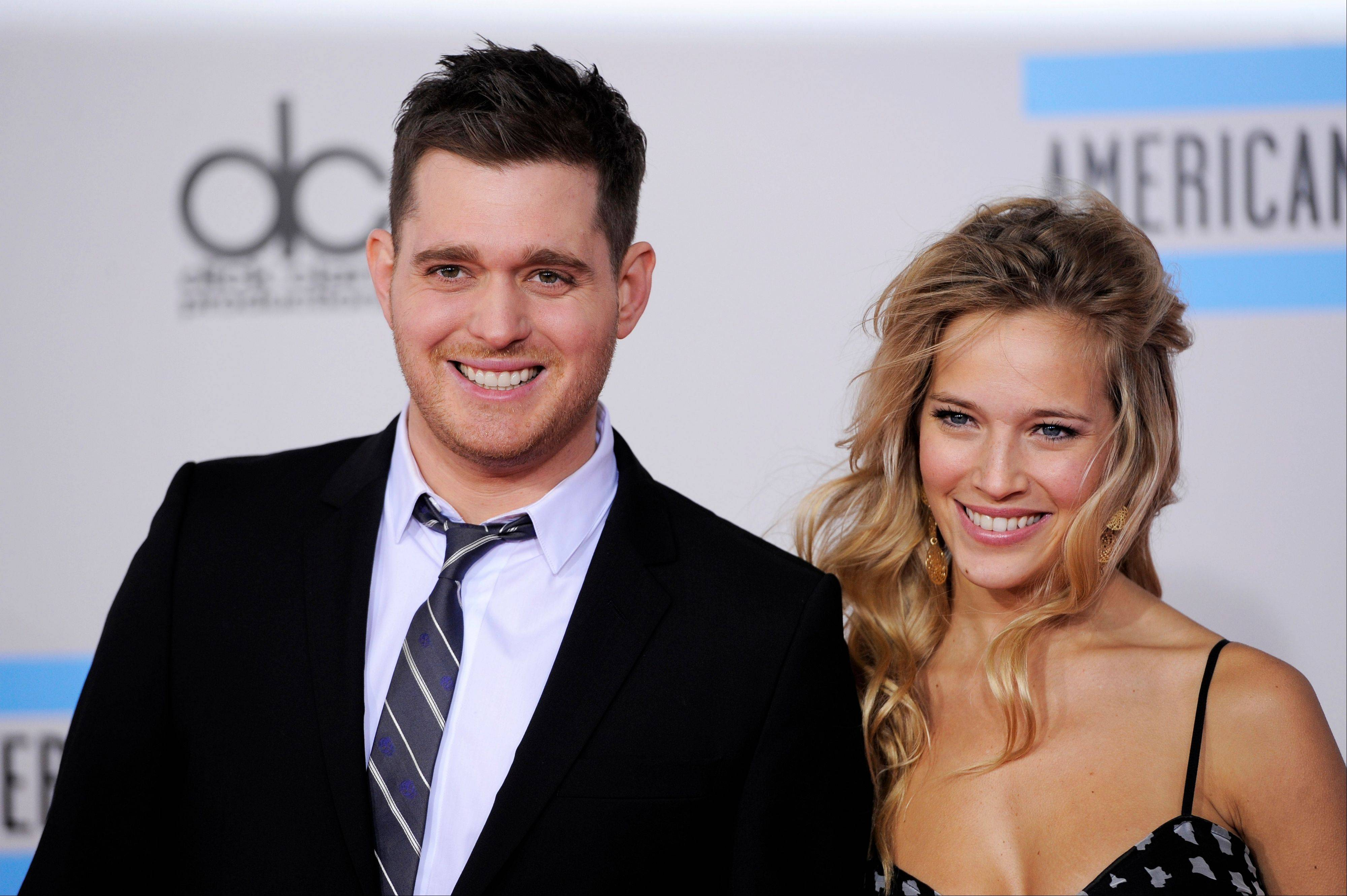 Michael Buble, left, and Luisana Lopilato at the 38th Annual American Music Awards in Los Angeles. The 37-year-old Canadian singer and his 25-year-old Argentine actress-wife are expecting a baby.
