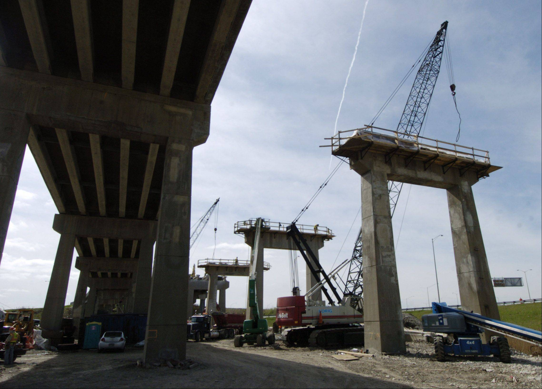 Gilbane Building Co. will check out old tollway projects to make sure the agency was getting its money�s worth.