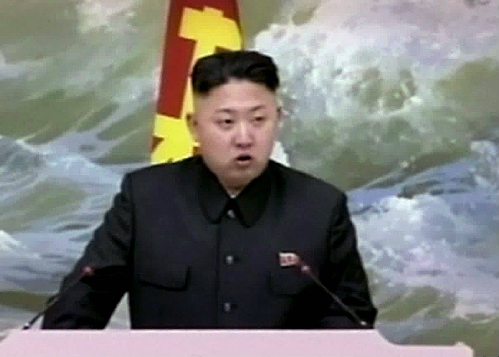 North Korean leader Kim Jong Un speaks at a banquet for rocket scientists in Pyongyang, North Korea, Dec. 21. North Korea's top governing body warned Thursday the regime will conduct its third nuclear test in defiance of U.N. punishment, and made clear that its long-range rockets are designed to carry not only satellites but also warheads aimed at striking the United States.