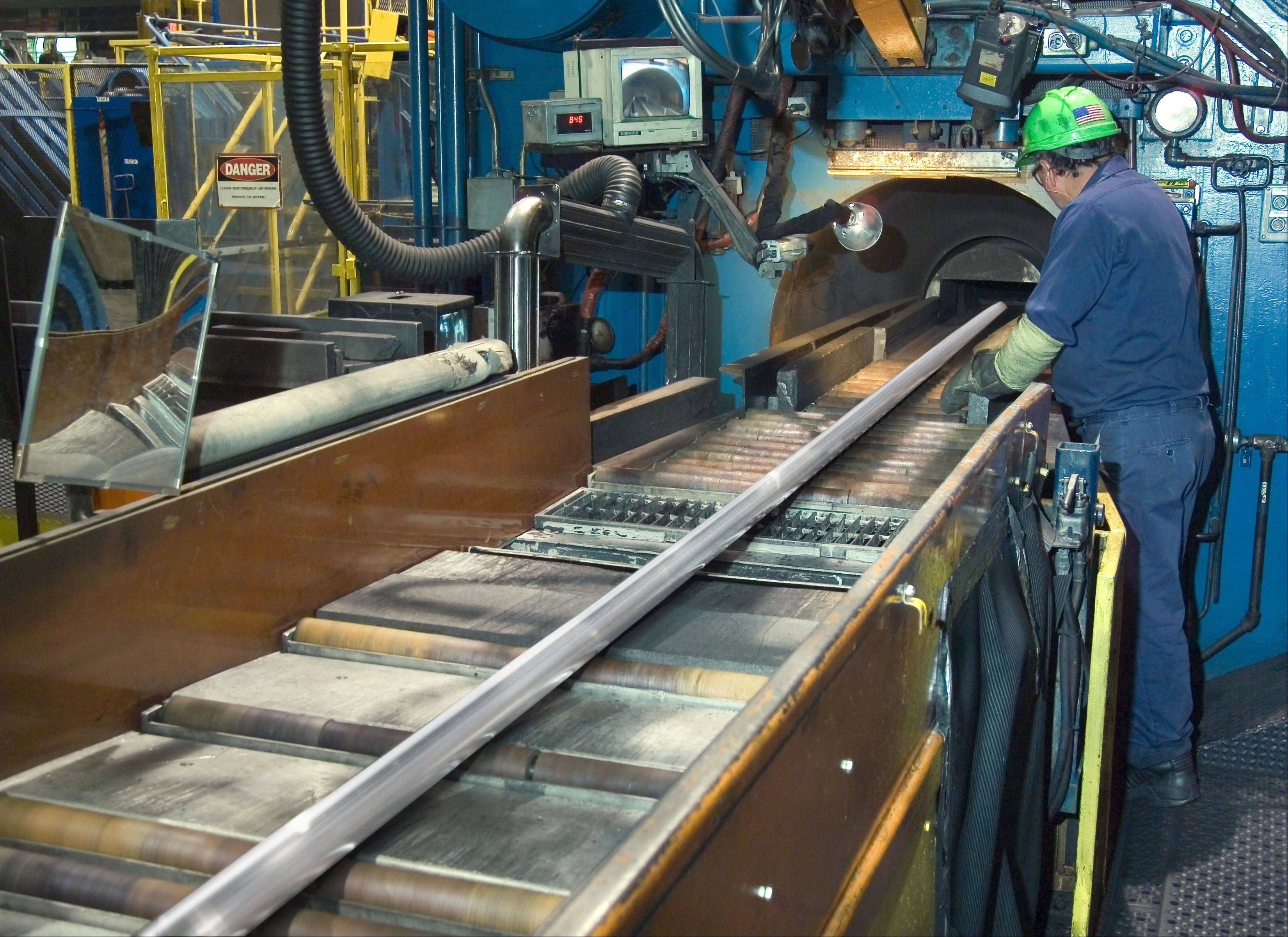 Pieces of aluminum are shaped by this press in a factory run by Sapa Extrusions, which is headquartered in Rosemont.